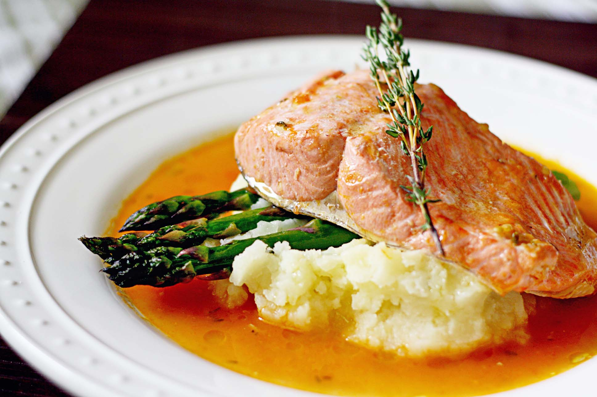Perhaps there is a better meal than salmon, garlic mashed and asparagus, we just don't know what it would be. Just like we don't know why they placed a small tree branch on our food.