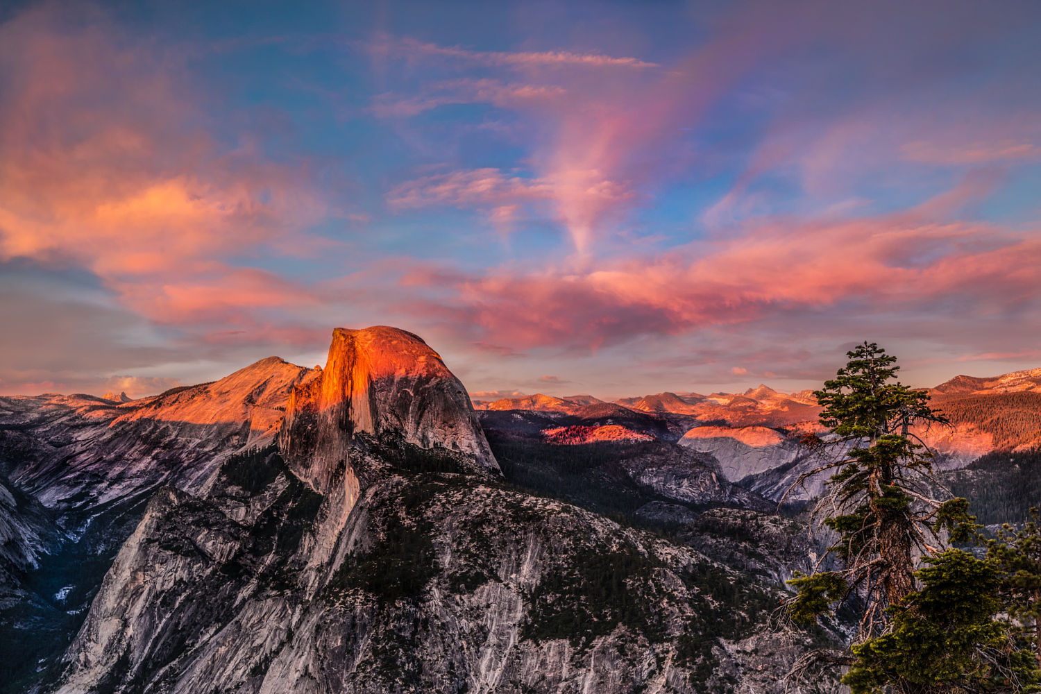 Half Dome at sunset. This occurs right before the sun disappears and the stars magically appear in the sky. And this event seemingly takes place every day.