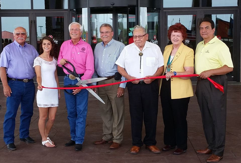 """Cherokee Nation Tribal Councilor David Thornton and his granddaughter Alexus Thornton at the new Cherokee Casino ribbon cutting ceremony. The gentleman on the left refused to hold the ribbon. Said Elmer Jenkins, """"I wanted to hold the ribbon. But every time I grabbed it that dickweed Running With Yellow Shirt pulled it back into his pocket."""""""