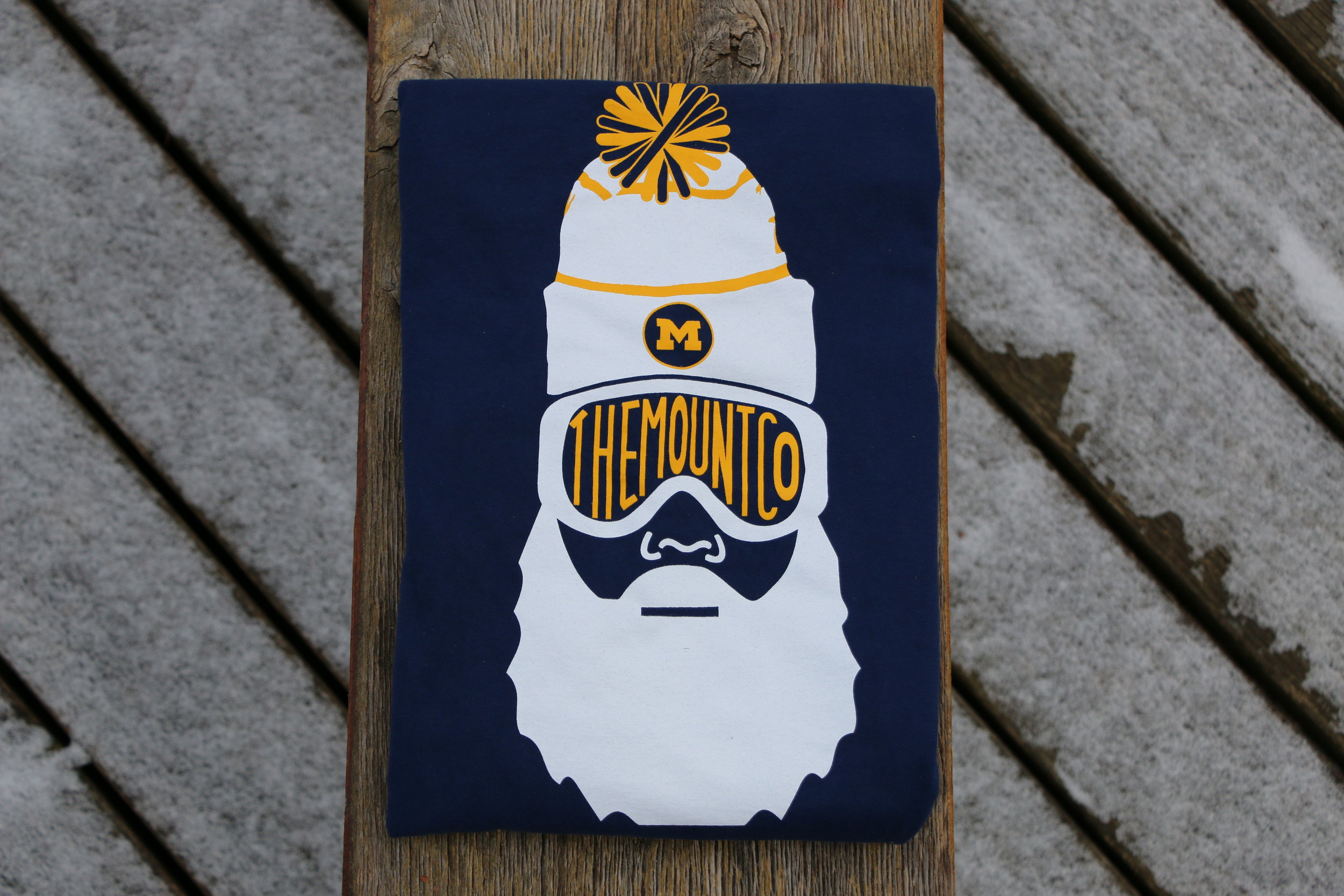 University of Michigan ski team hanging with the bearded man.