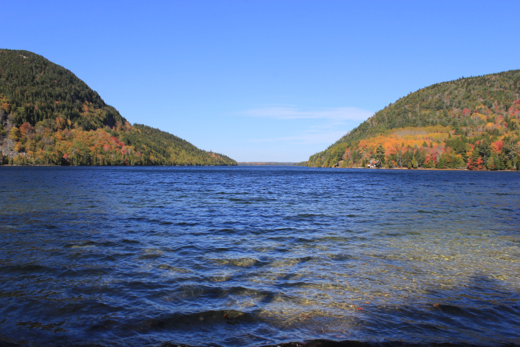 JORDAN POND. THE SOUND OF SOFT CLEAR WAVES TUMBLING OVER SMALL ROCKS BEFORE GREETING THE SHORE OF THE SMALL MOUNTAIN LAKE. ALSO KNOWN AS A TARN.