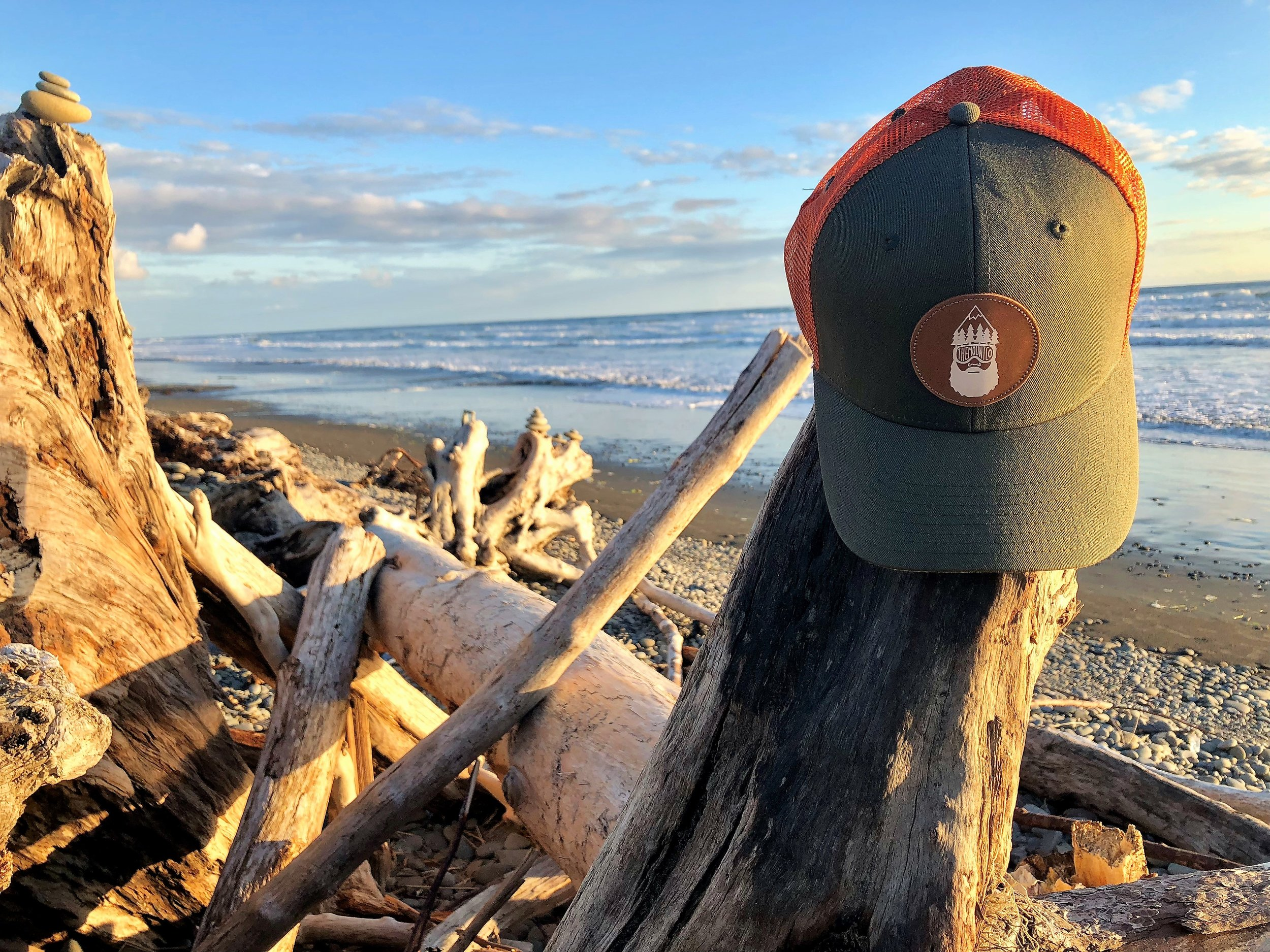 TMC hat on beach.JPG