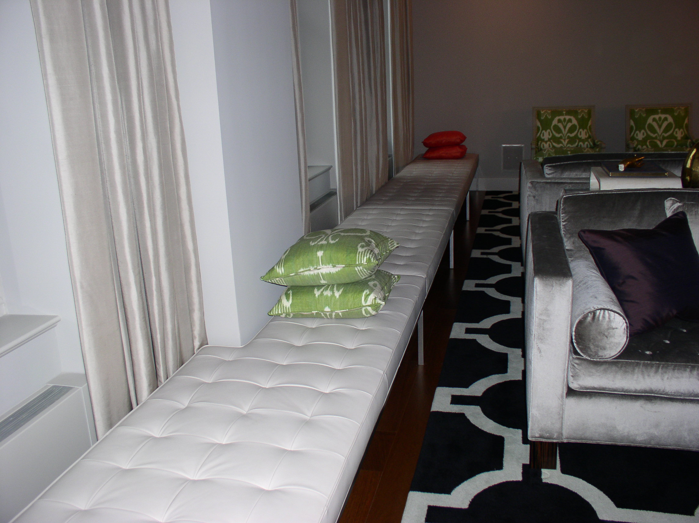 custom bisquit tufted bench with metal base.JPG