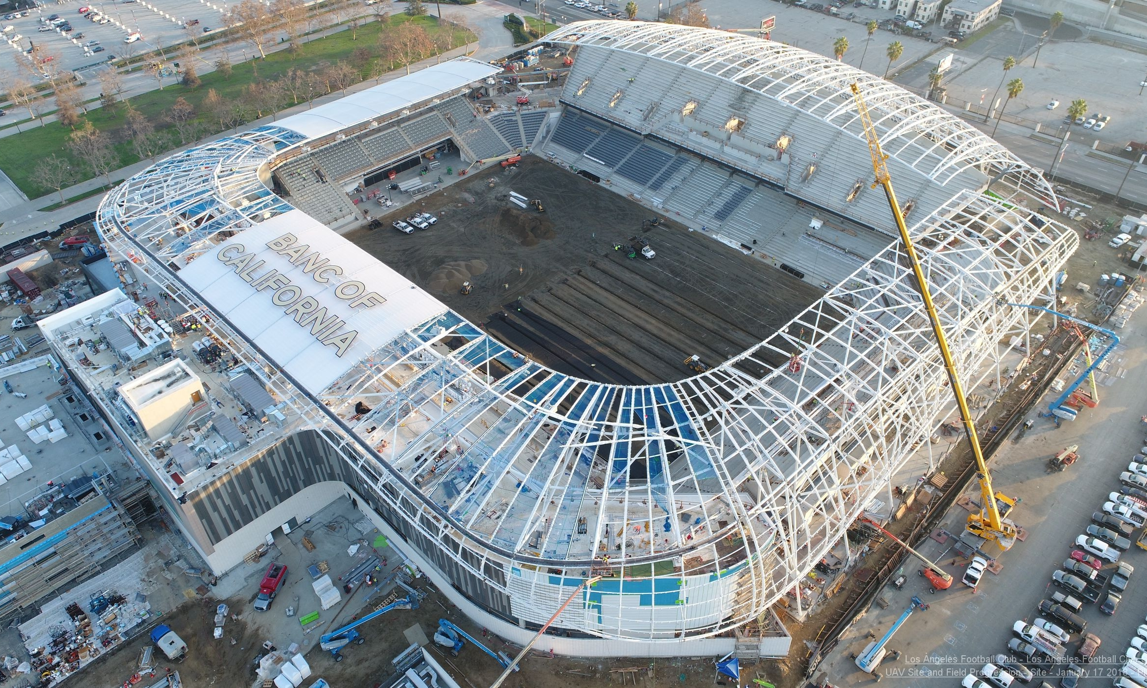 The stadium during construction—the engineering for the roof lettering was completed by WPe.  [Multivista]