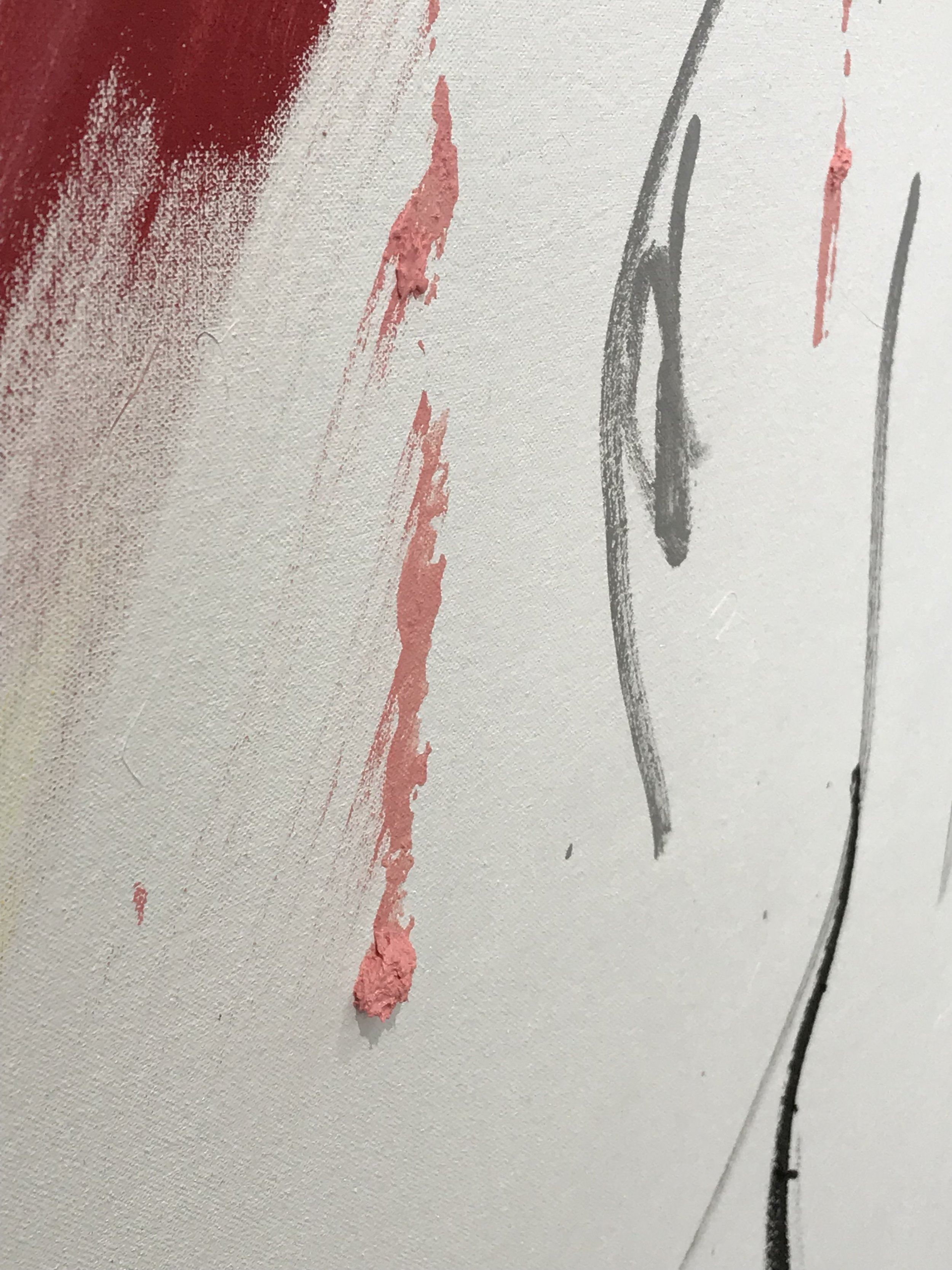 clumps of paint left on a canvas