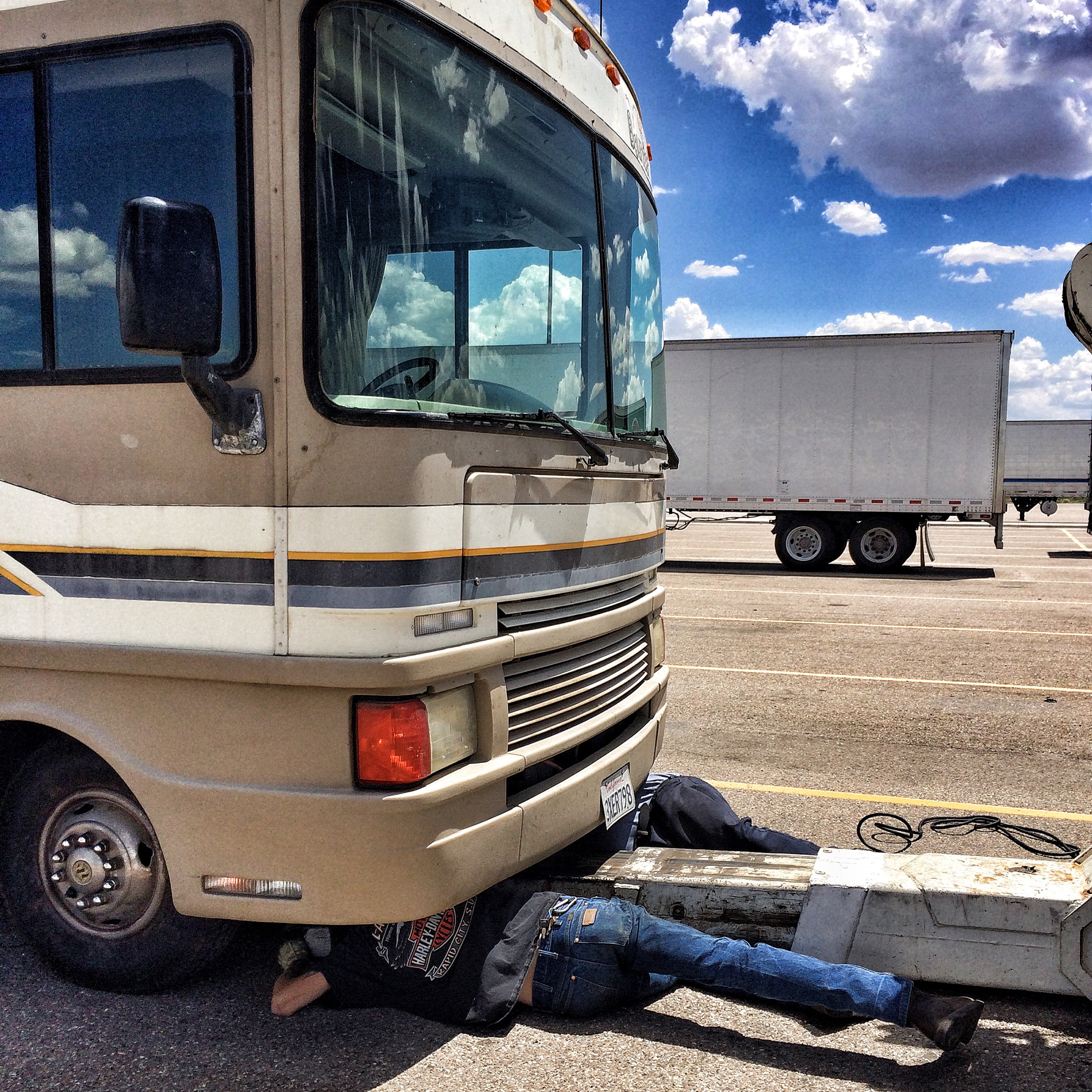 My caption for this photo that day on Instagram:  At one point while these nice guys struggled with my stubborn motorhome to get her towable, I kind of hiccup-giggled because the thought crossed my mind that my diva motorhome just wanted men underneath her again. That was better than screaming to the heavens or dissolving into crying fits, but those emotive states are rather near the surface just yet.