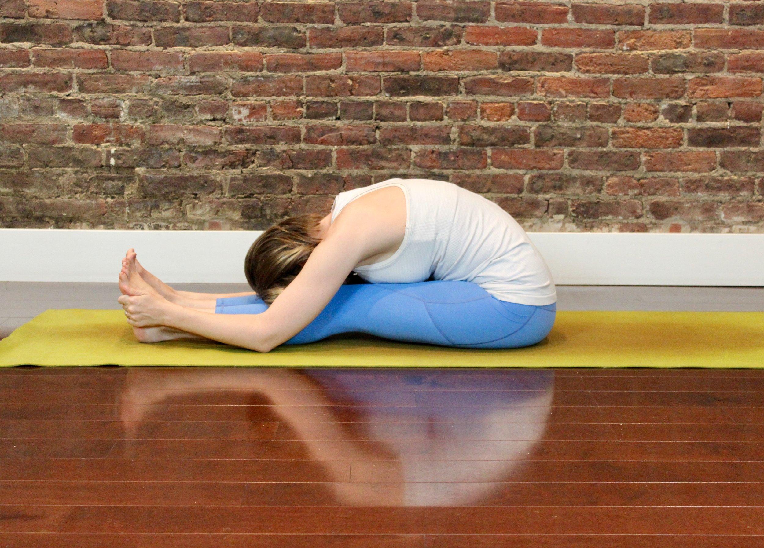 First for Women Mag Yoga Lara Alexiou forward fold.jpg