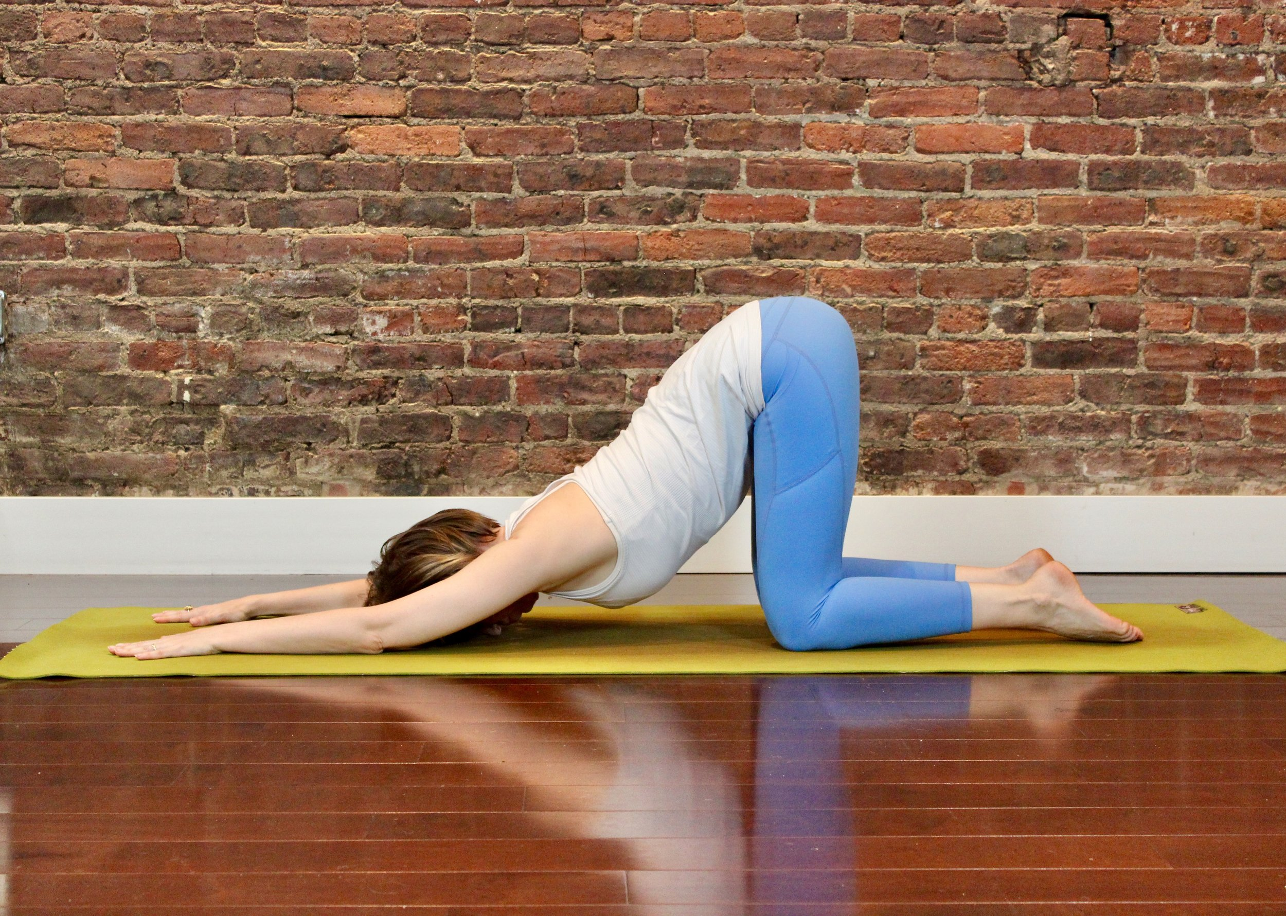 First for Women Mag Yoga Lara Alexiou puppy pose.jpg