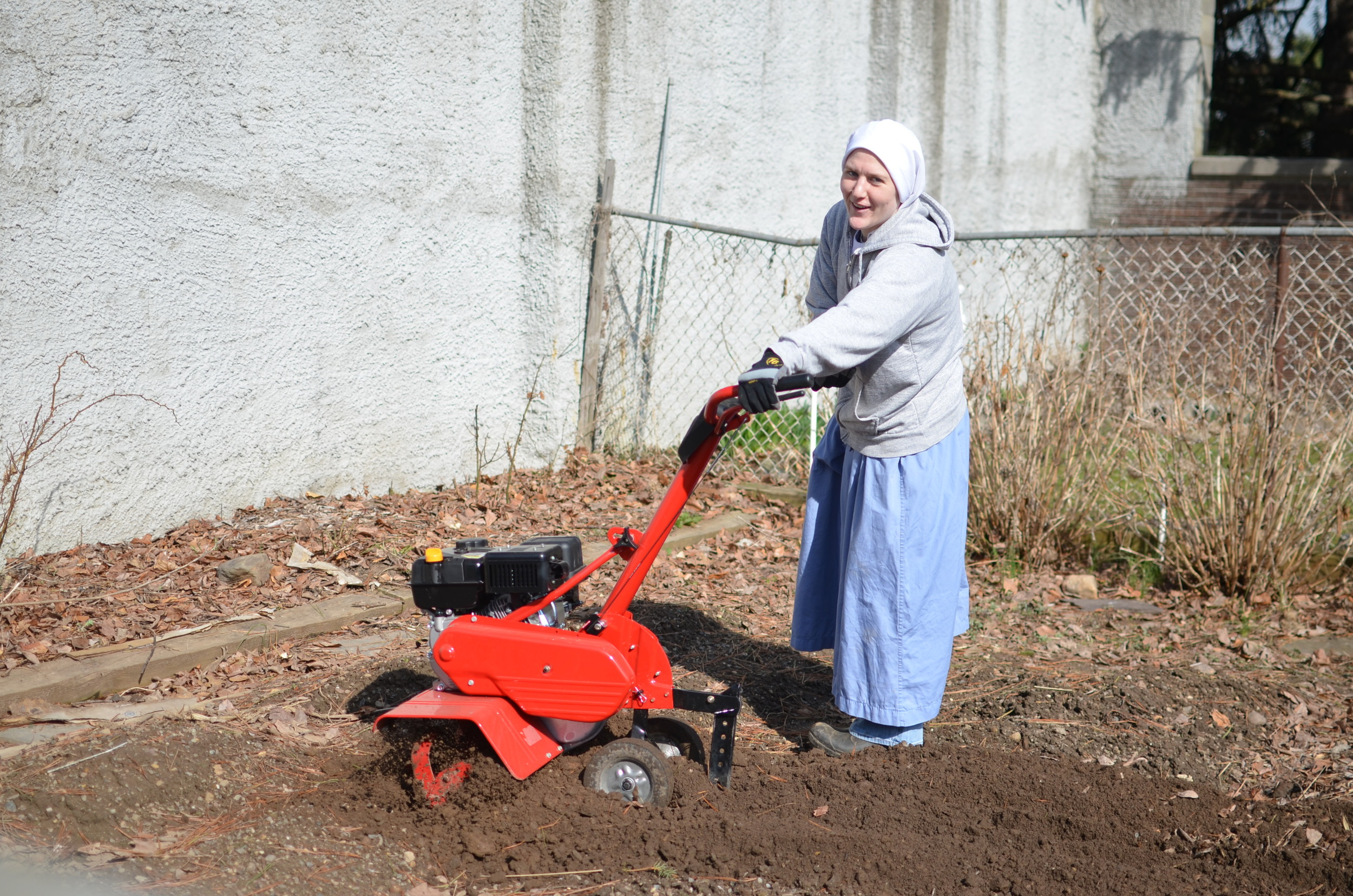 Sr. Mary Magdalene is happy to till the garden for another year of planting!