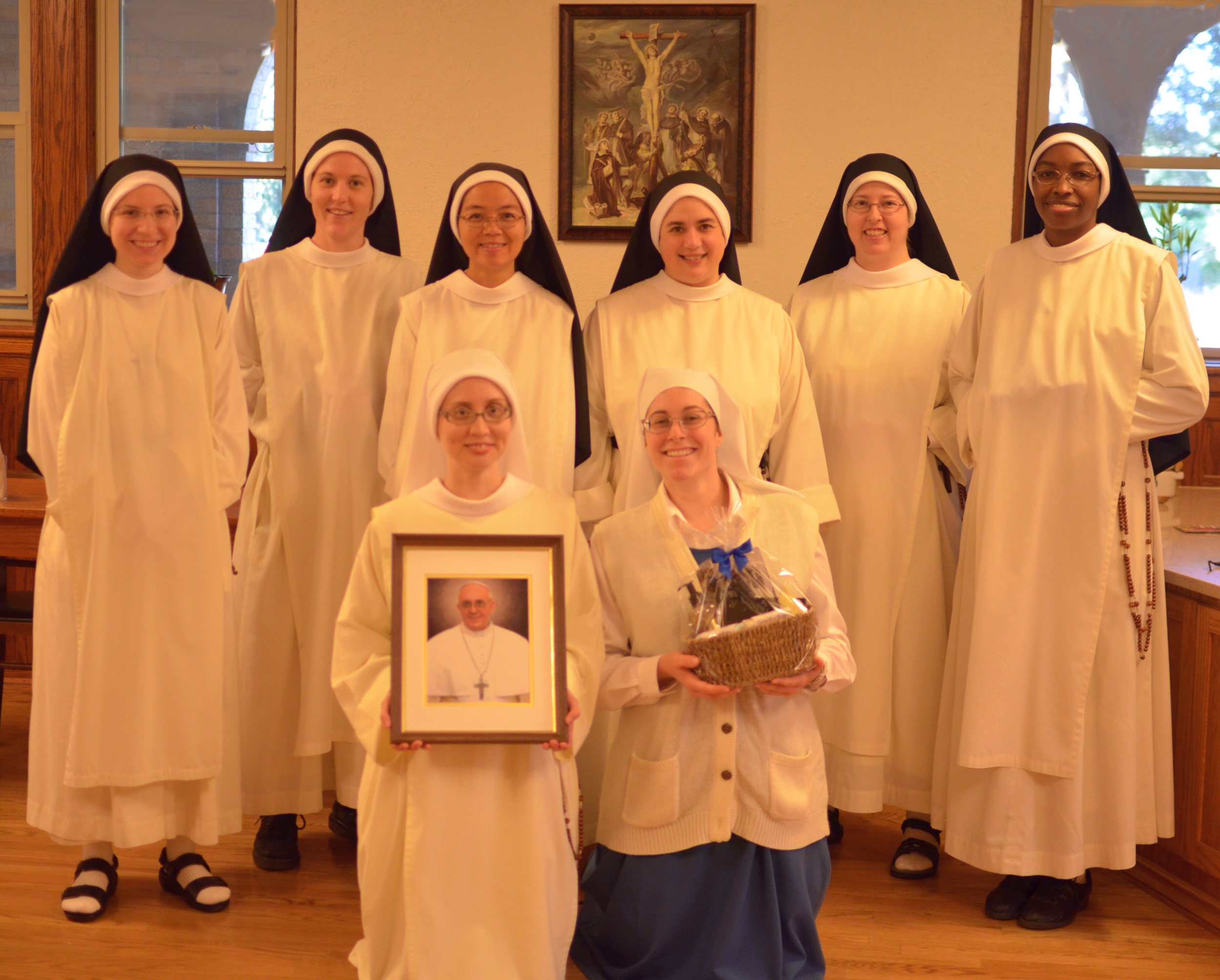 The sisters who work in the soap department pose with our picture of Pope Francis and his soap.