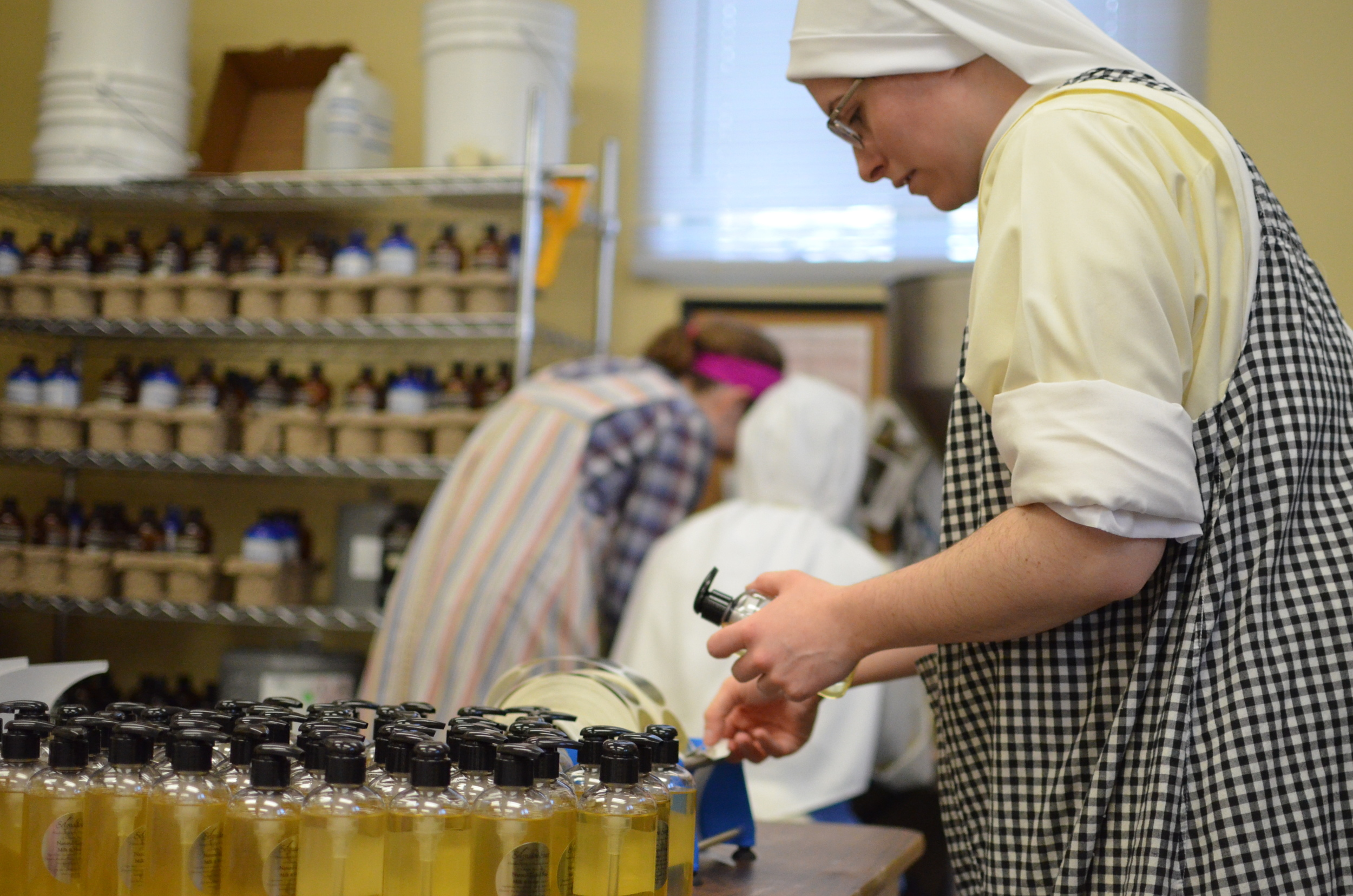Sr. Mary Ana labels each bottle, makes sure the caps are on tight and the bottle is clean of any residue!