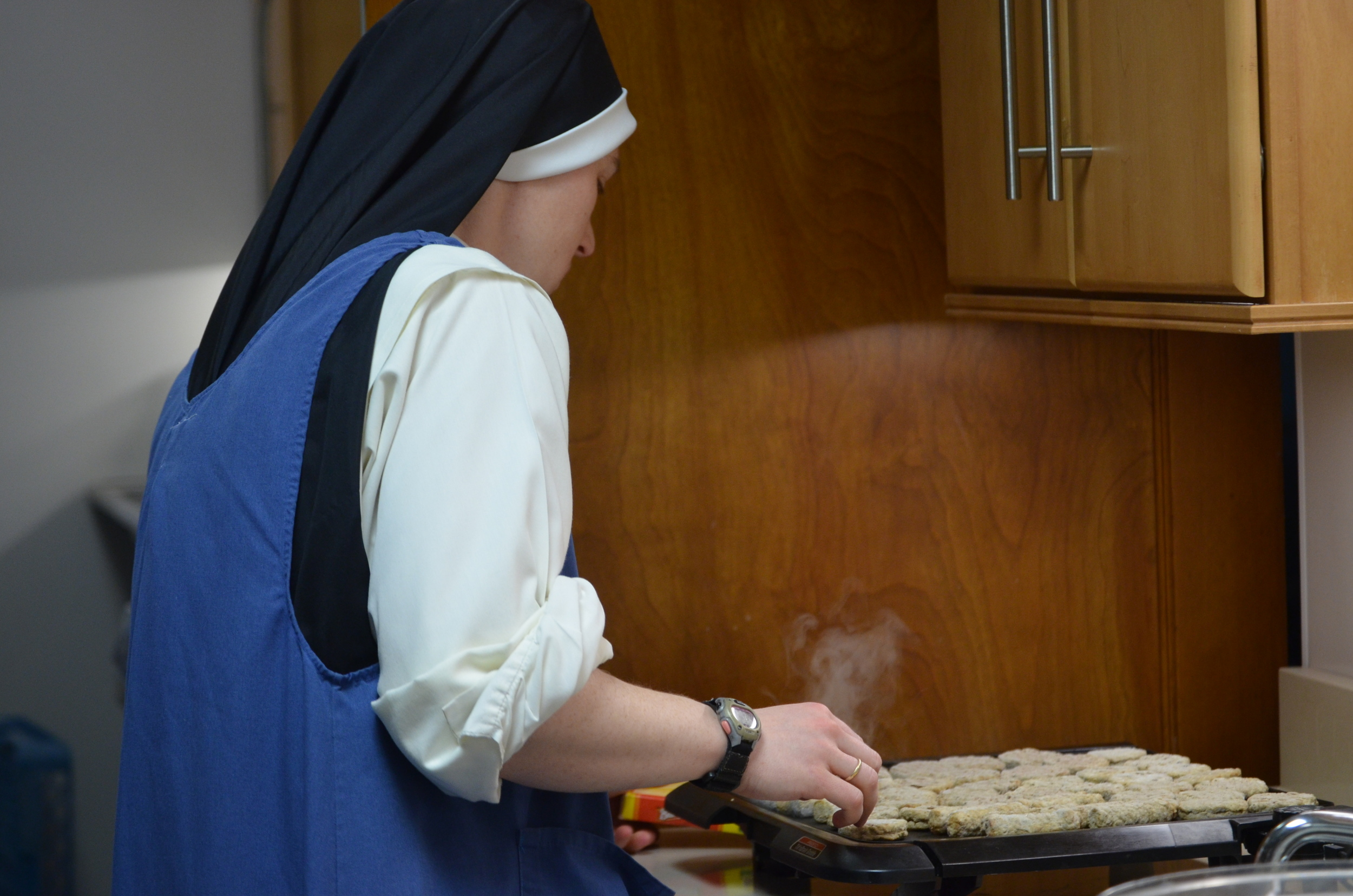 Sr. Mary Magdalene cooks up sausage