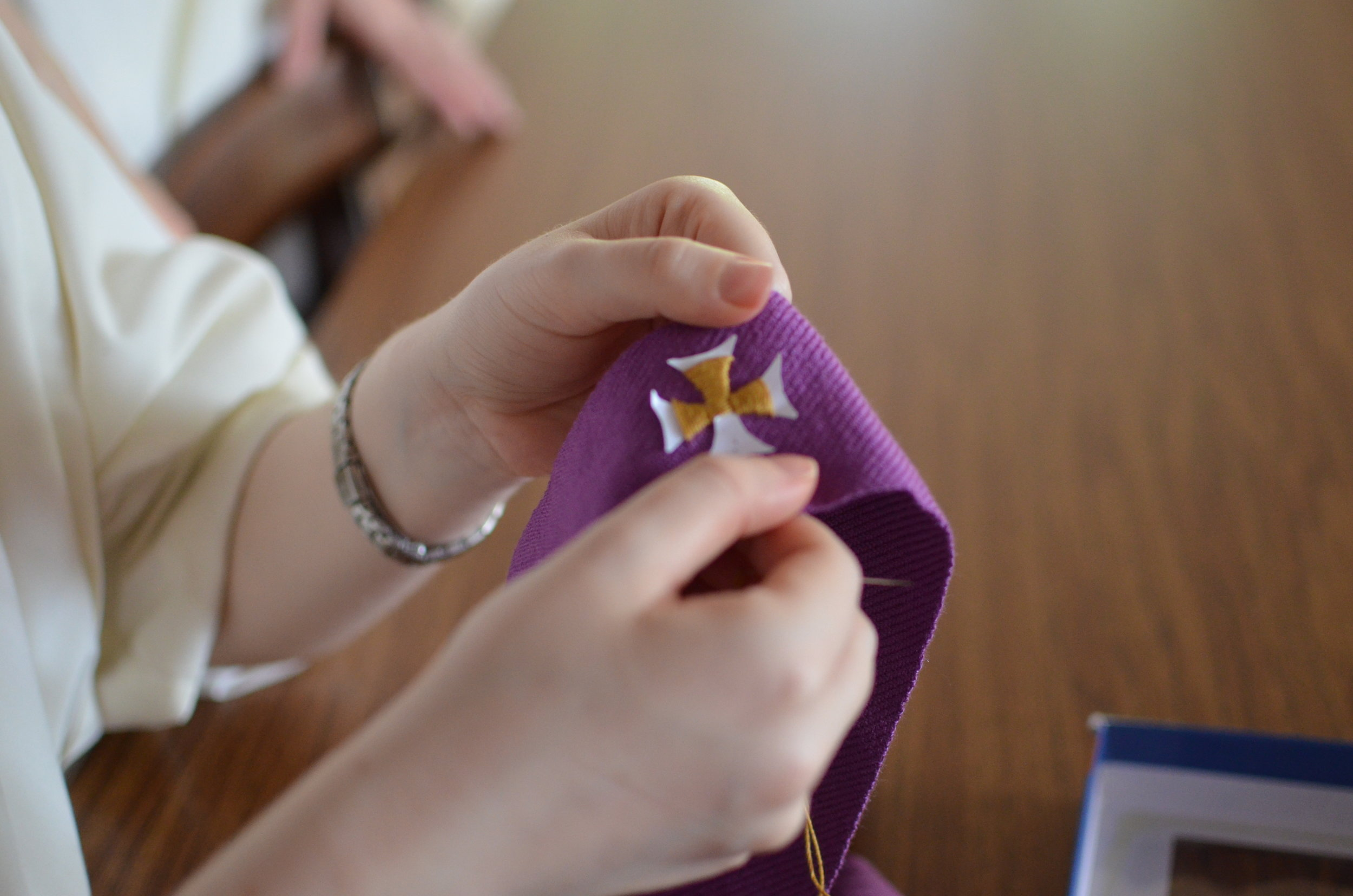 7) The last part is embroidering on at least the middle cross. Here Sr. Mary Veronica is embroidering on the cross.