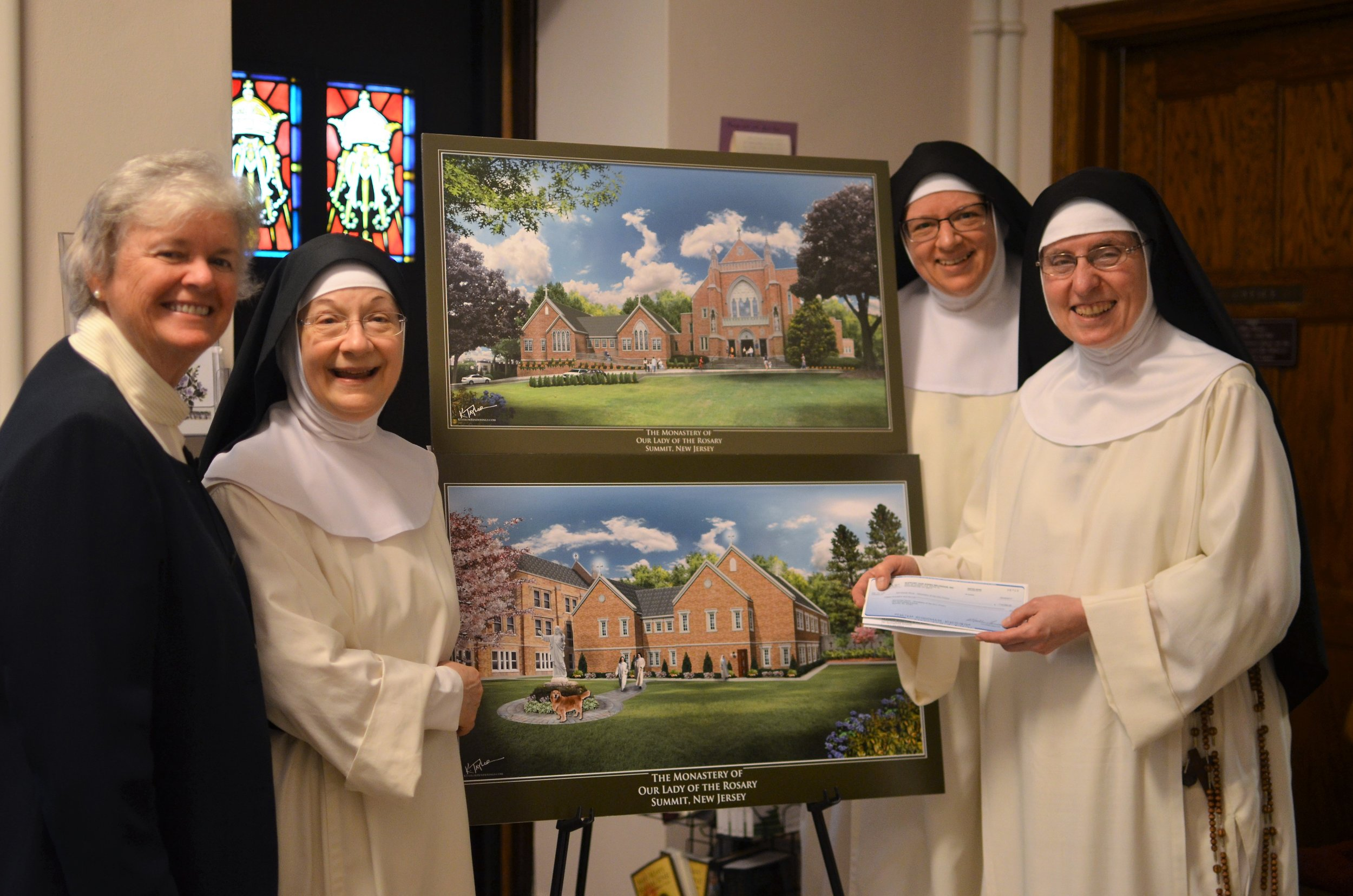 Sr. Patricia Codey, SC, Board Member of  Support Our Aging Religious , presented the community with a $15K grant check for our new wing's handicap ramp.