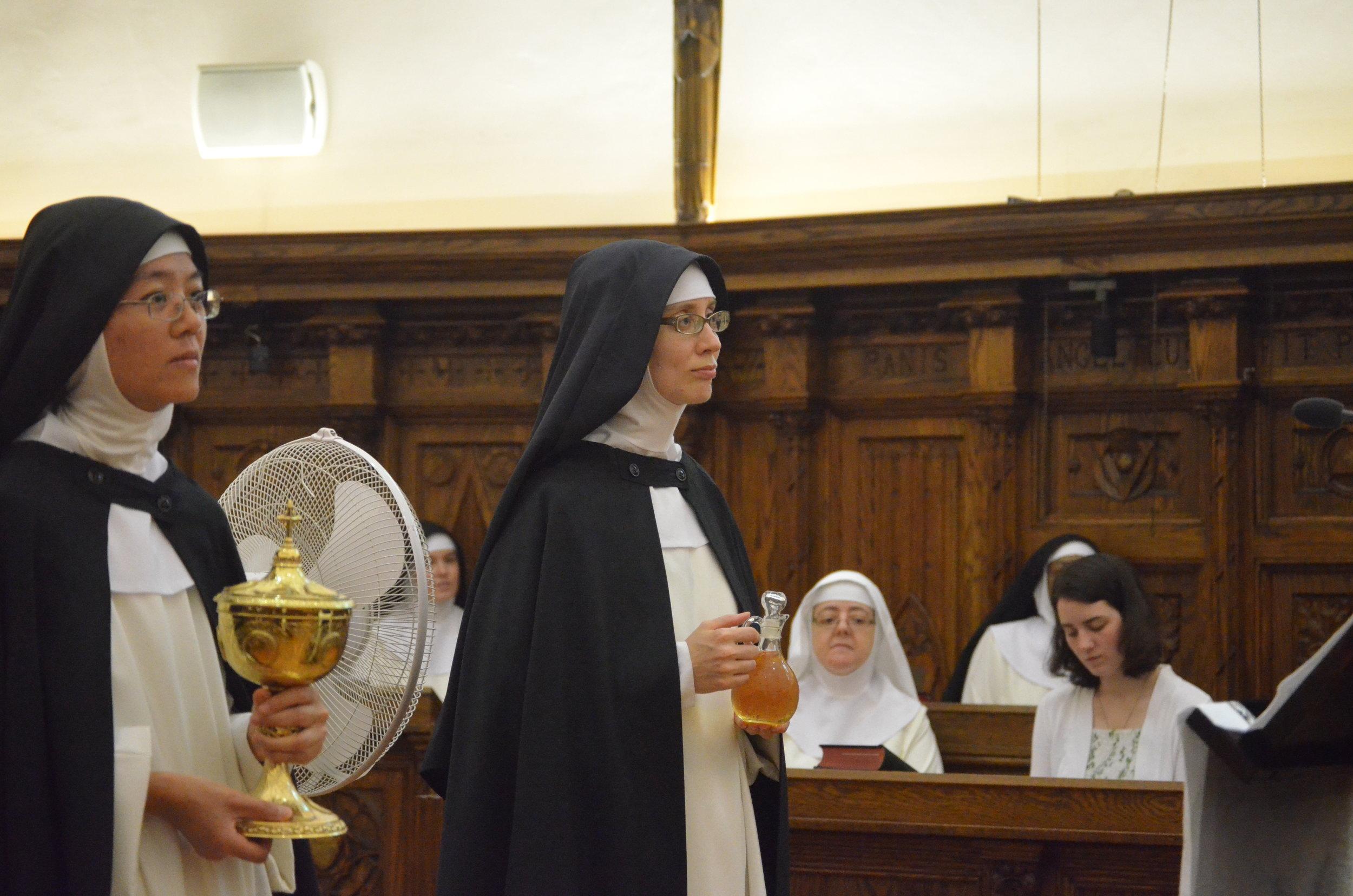 Sr. Maria Johanna brings up the gifts with her novice mistress, Sr. Joseph Maria