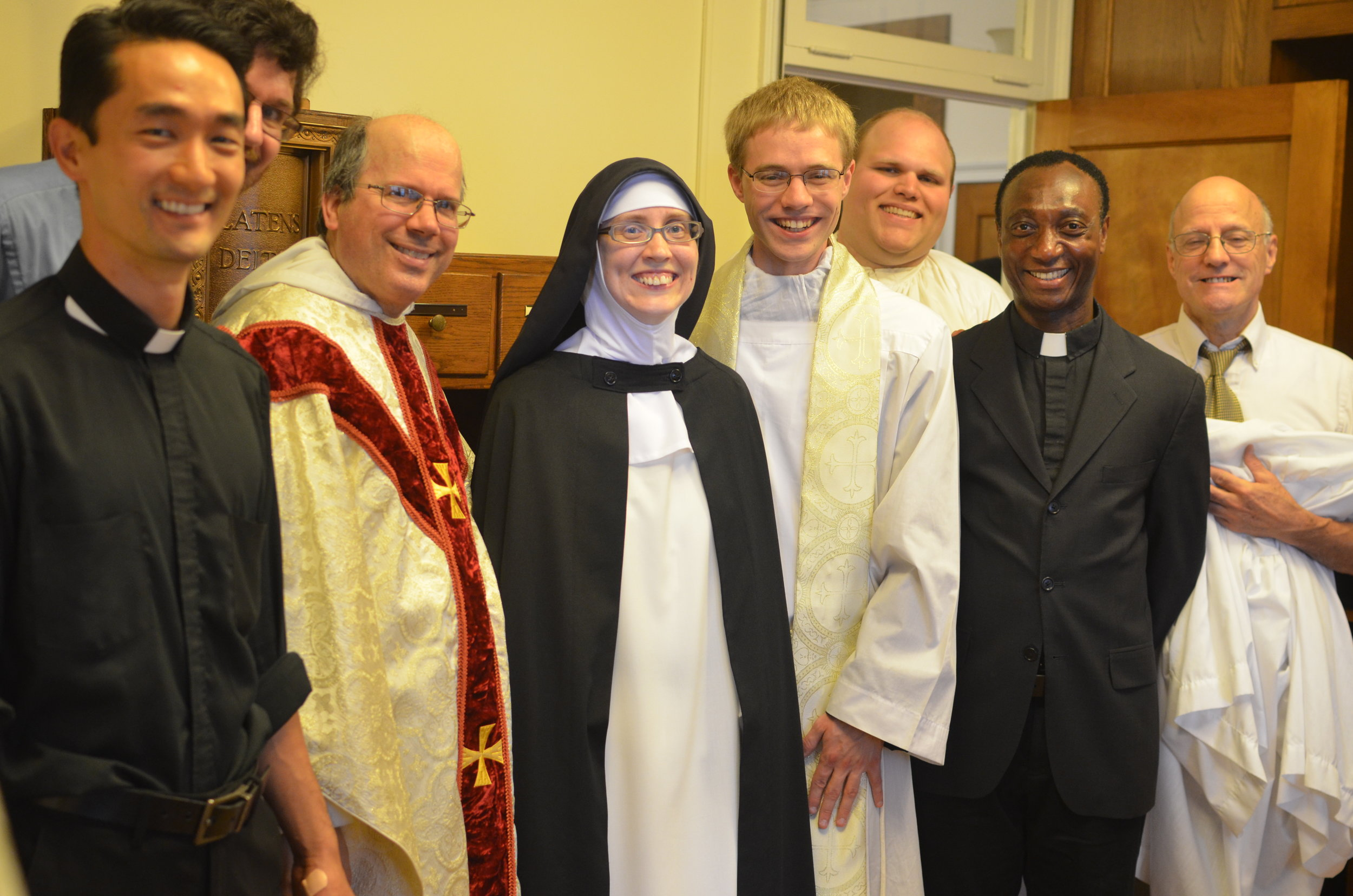Sister with some of the priests and acolytes after Mass