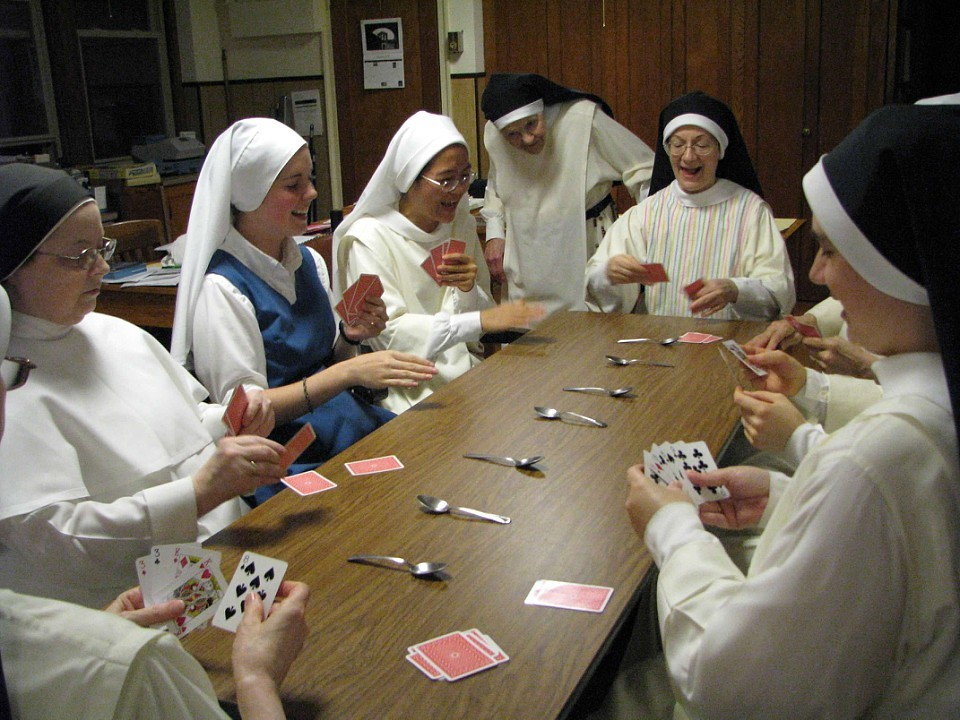 Sr. Mary Ellen Timothy watches a game of spoons at evening recreation