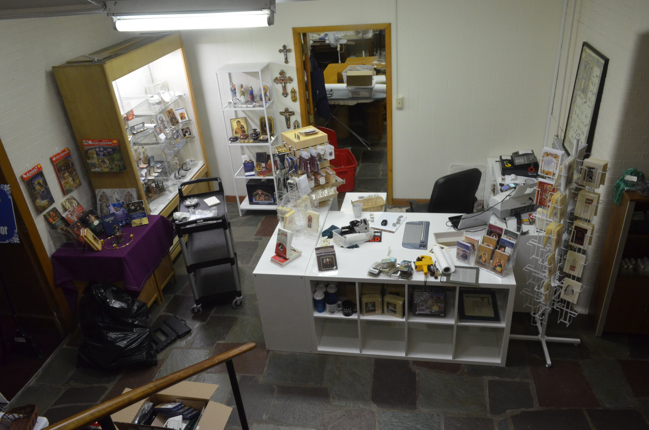 That door in the back is actually an enclosure door to the nuns' sewing room where a lot of the gift shop stock will be stored.
