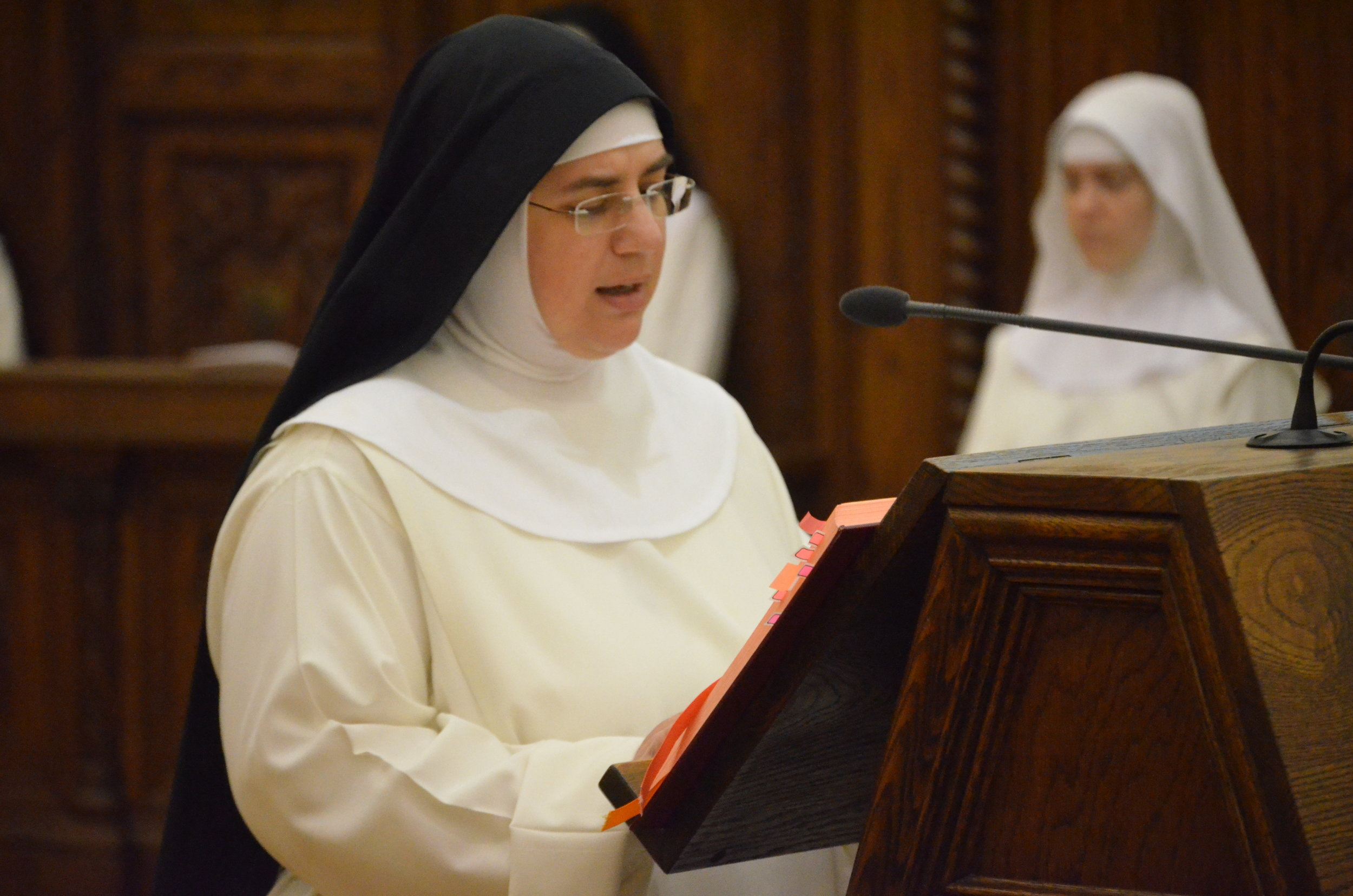 Sr. Mary Catharine chants the First Reading