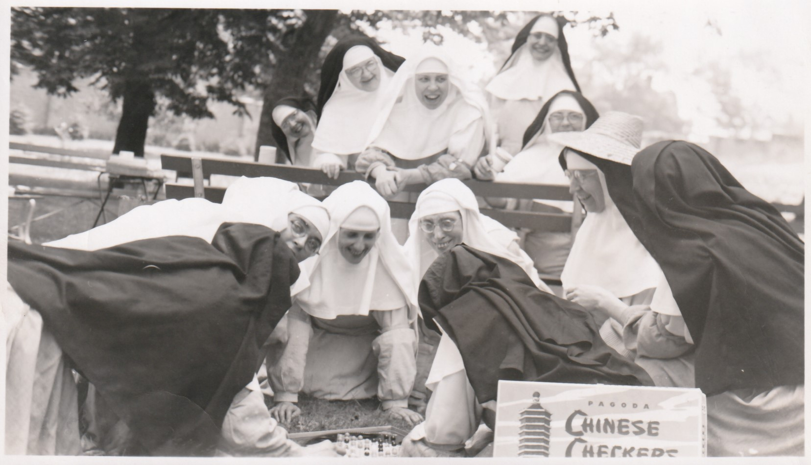 Playing Chinese Checkers at a picnic, early 1950s.jpg
