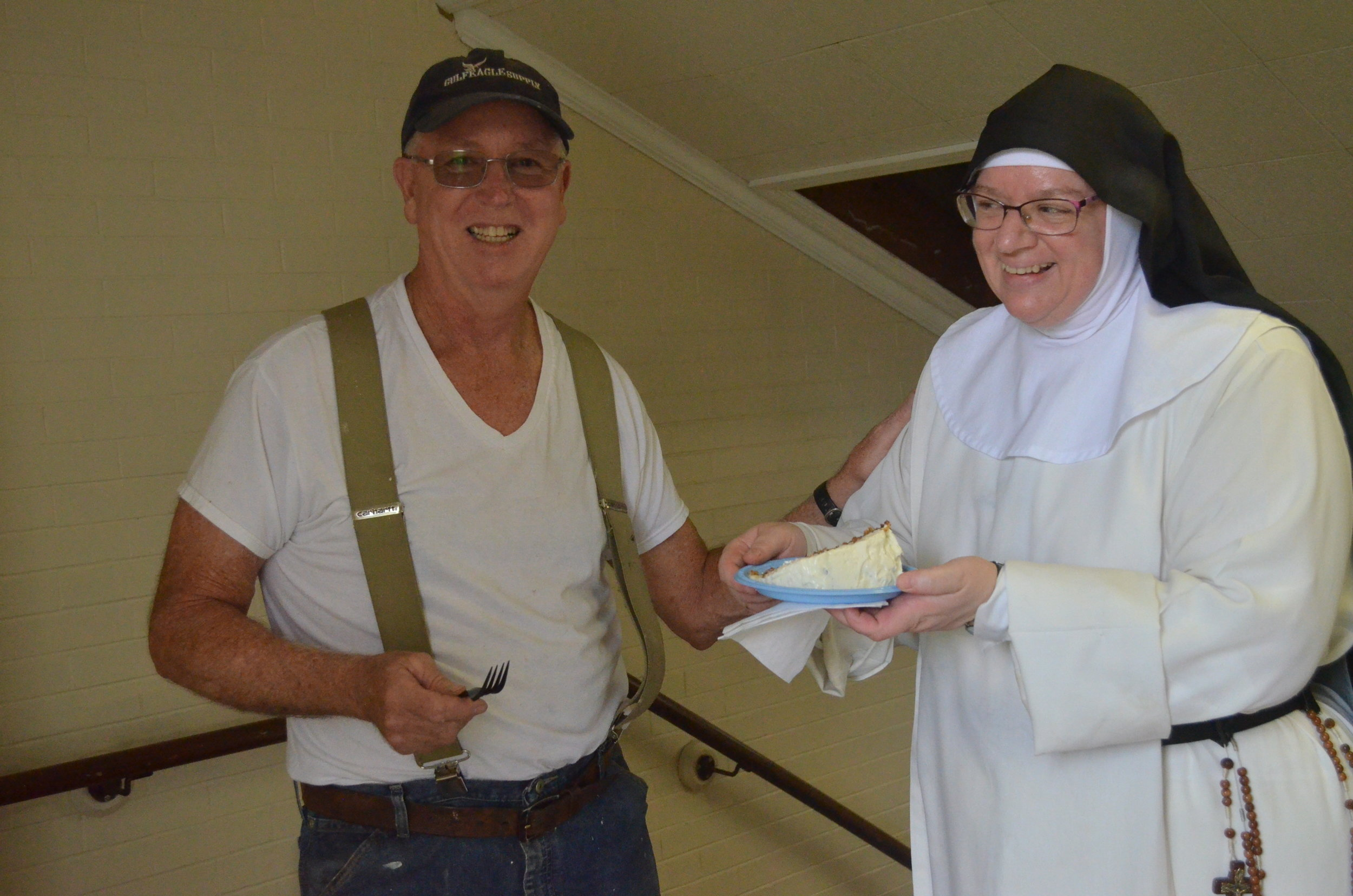Sr. Judith Miryam gives Jay a piece of her famous carrot cake. It's his favorite!