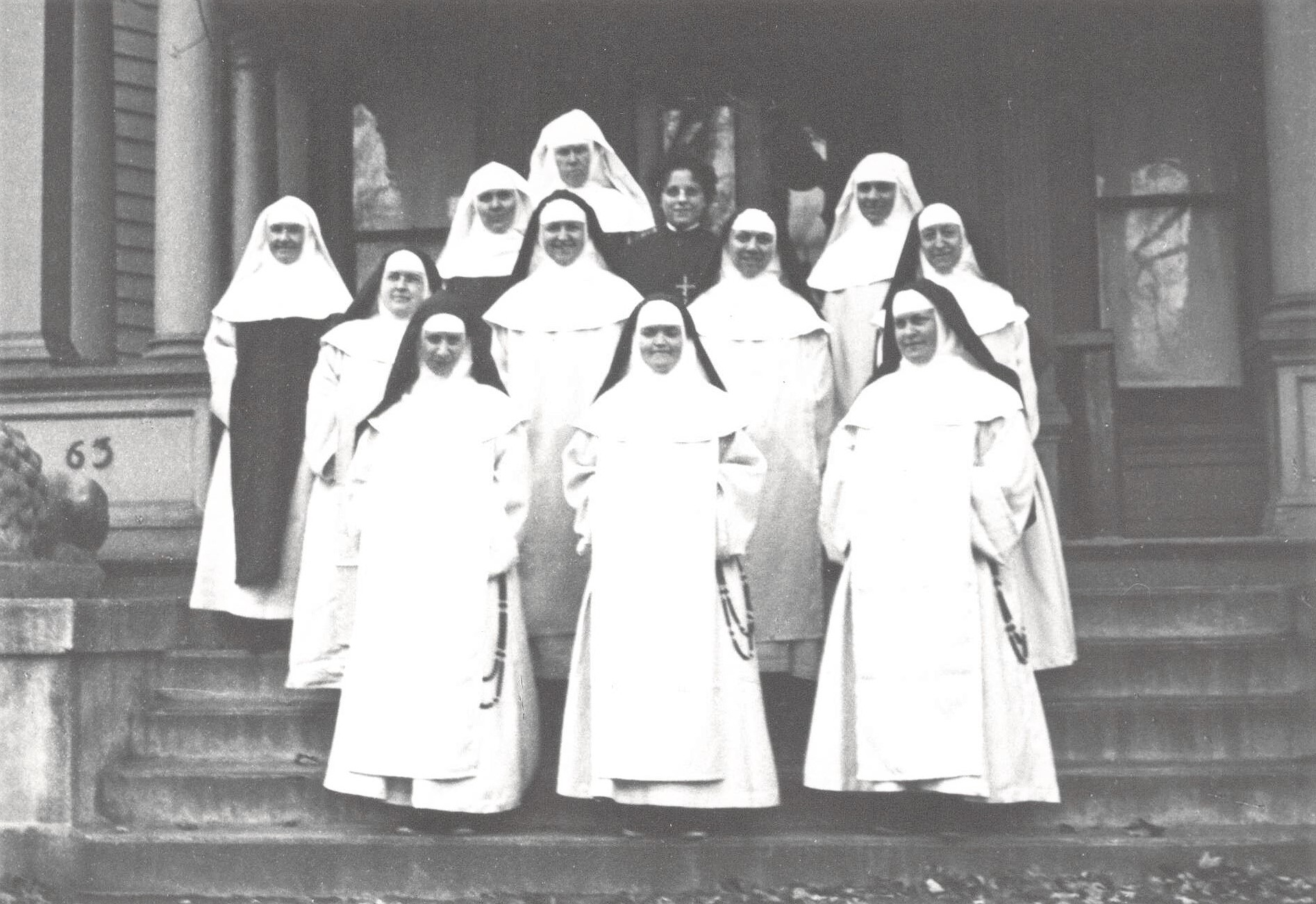 The founding sisters in 1919, on the front steps of the first monastery. Two lay sisters are missing from the picture.