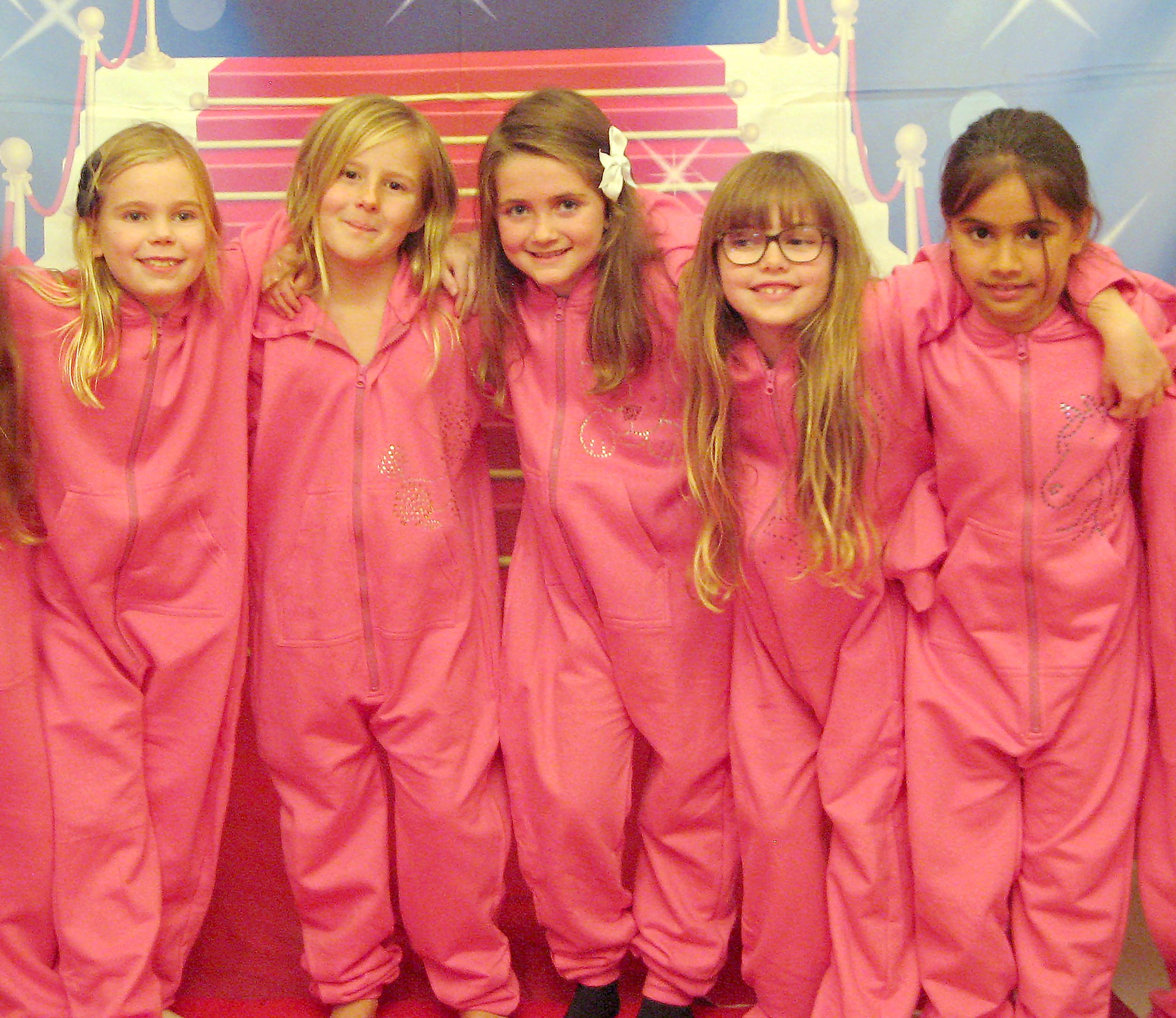 girls showcasing their onesie's made at luvlybubbly