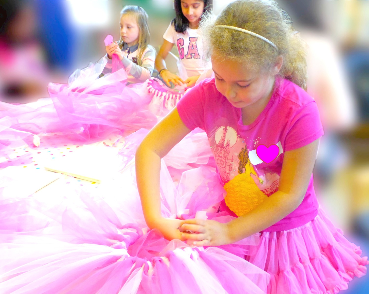 Girls making tutus at Luvlybubbly Fashion Catwalk Party
