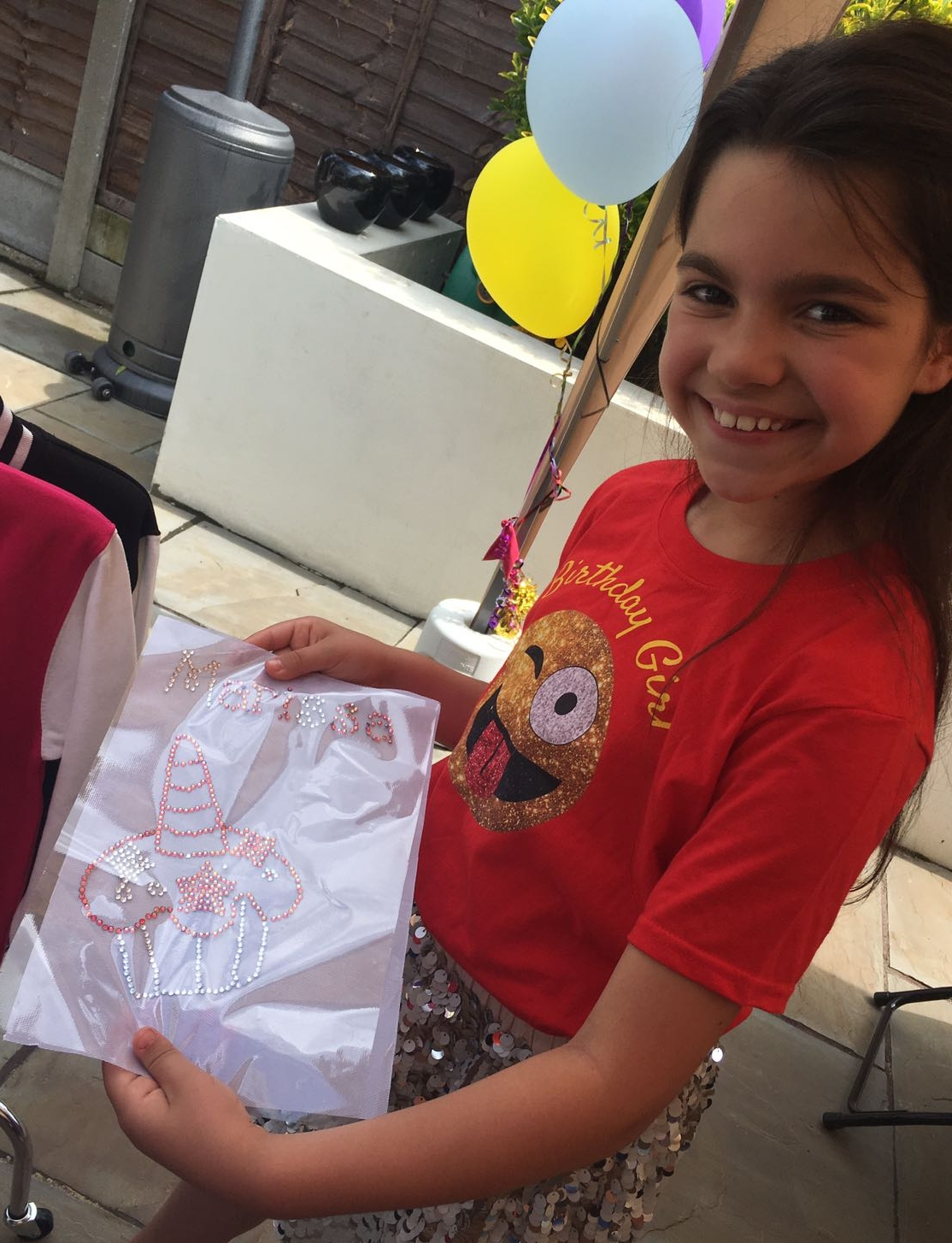 girl proudly showing her design