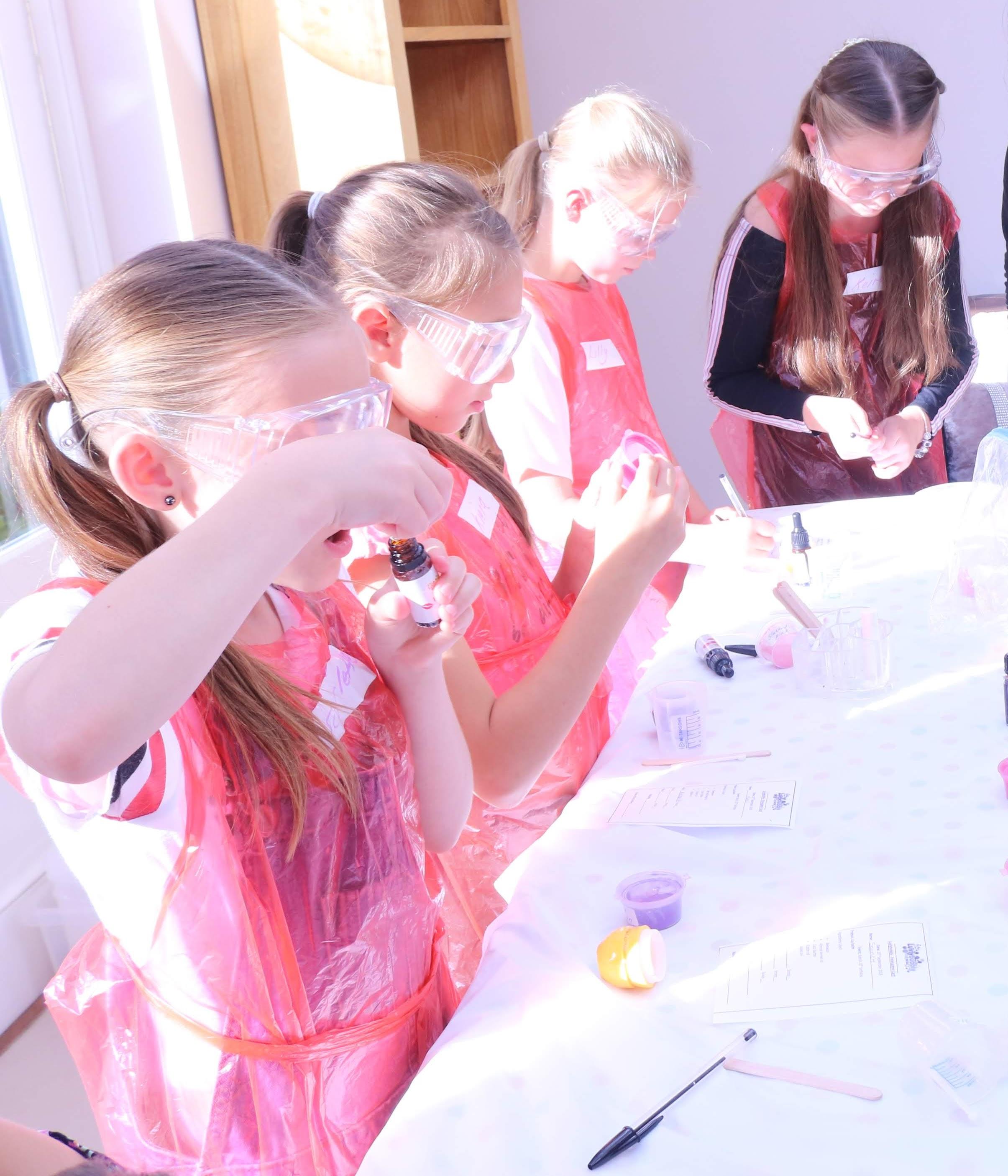 girls making lip balm.JPG