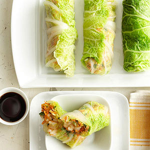 Napa Cabbage Spring Rolls  By Midwest Living/Food  Yield: 8 spring rolls (16 pieces)  Hands On 25 mins  Total Time 1 hr  Once assembled, these fresh vegetarian appetizers benefit from allowing the surface to dry a little, so making them an hour or so in advance of serving is a good idea. The recipe comes from chef Kevin Shinn of Bread and Cup in Lincoln, Nebraska.  ingredients   1/2  cup Arborio rice or long grain rice   1  tablespoon sea salt or kosher salt   4  cups ice cubes   1  head Napa cabbage or savoy cabbage   1  cup shredded or grated carrot   1/2  cup finely chopped green onion   2  tablespoons snipped fresh flat-leaf Italian parsley   1  tablespoon sesame oil (not toasted)   1/4  teaspoon lime zest   2  teaspoons lime juice   1/2  teaspoon sea salt or kosher salt   1/4  teaspoon ground black pepper  Soy sauce or teriyaki sauce  directions  For rice: In a medium saucepan, bring 1 cup water to boiling. Slowly add rice and return to boiling; reduce heat. Simmer, covered, about 15 minutes or until most of the water is absorbed and the rice is tender. Remove from heat. Let stand, covered, for 5 minutes. Uncover; let rice cool.  For wrappers: In a large pot, bring 12 cups water and the 1 tablespoon sea salt to boiling. Meanwhile, place the ice in a large bowl with 8 cups cold water.  Remove eight outer leaves from cabbage. Make a cut through each leaf at the base, trimming out some of the woody stem. Set the remaining head aside.  Carefully place trimmed leaves in the boiling water for 30 to 60 seconds or until just wilted, then transfer them to the ice water for 60 seconds. (Tongs are the best tool for the job.) Remove leaves from cold water one at a time, and lay flat on a cloth towel. Set aside to dry.  For filling: From the remaining cabbage, finely chop enough to measure 13/4 cups. In a large bowl, combine the chopped cabbage, carrot, green onion, parsley, sesame oil, lime zest, lime juice, the 1/2 teaspoon sea salt and the pepper.  About one hour before serving, assemble rolls. First, squeeze out any excess water from the filling. Then lay a blanched cabbage leaf flat on the counter with the base end toward you. Place 1/4 cup of the filling in the center of a leaf; place 2 tablespoons of rice on top of the filling. Fold stem end and sides over filling and roll up tightly, taking care not to tear. Place on a serving dish, seam side down. Let sit for about an hour. If you like, cut each roll in half diagonally to reveal the filling. Serve with soy sauce for dipping.  To serve, if you like, cut each roll in half crosswise on a diagonal to make 16 pieces. Serve with soy sauce or teriyaki sauce.