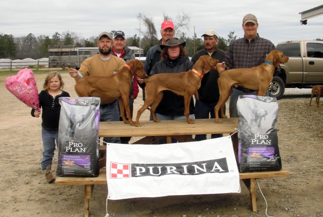 "Derby Classic   Dogs left to right: 3rd place - A Case XX for JT Becker (""Case""); 2nd place – Burr Oak's Durite (""Tess""); winner – CK Touchdown (""Guy"")   People left to right: Lily Fountain, Jamie Fountain, Gus Toombs (judge), Mark Johnson, Thersa Gimbut, Ben Lorenson (judge), Brian Gingric"