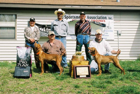 NC Winners: Kal Cam's Calamidy Jane with Owner Gordon Long and Onpoints Full O Gusto with Handler Barry Bassingthwaitte. Standing: Handler Daniel Burjan, and Judge Jim Michaeletz and Judge Conrad Plevnic