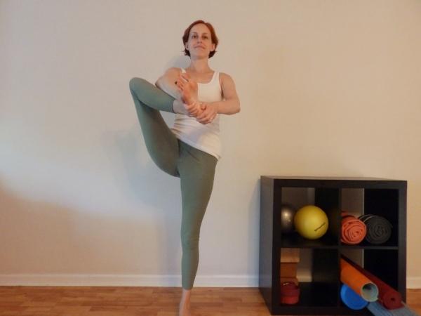 Standing PIGEON - Front / top leg foot moves toward breastbone, foot flexed. Back / bottom leg straight.