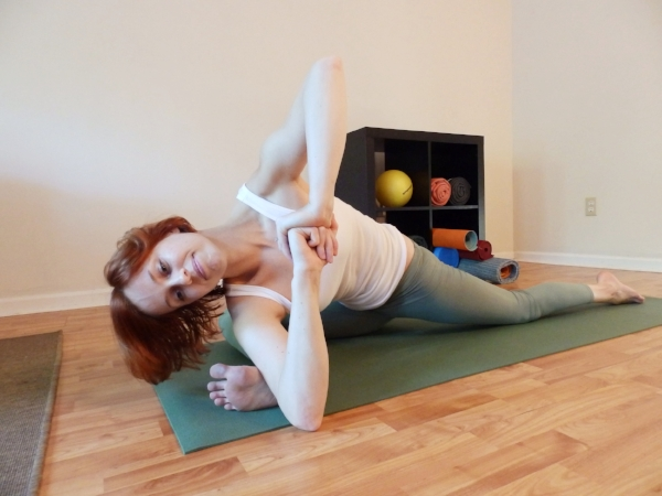 Twisting PIGEON Toward Foot - Sit down on the front leg hip. Front leg at a right angle, foot flexed. Back leg either straight or bent and splayed out. Twist toward foot and hook elbow or armpit into the arch of the front foot. Make a fist with bottom hand, other hand on top.