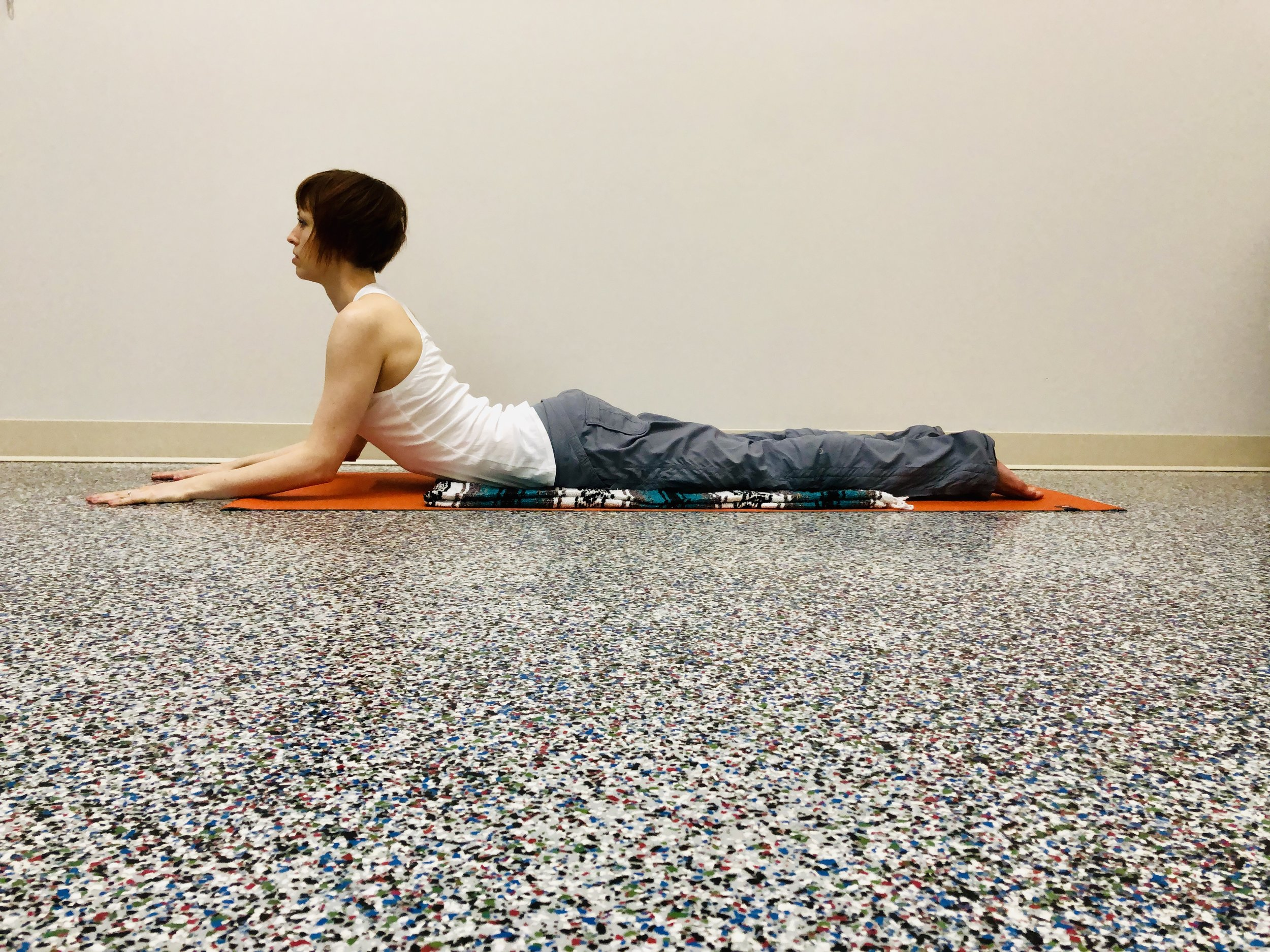 Bend elbows. Lengthen ribs forward.