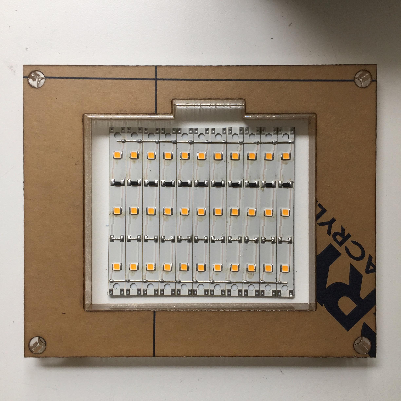 Laser cut housing and LED platform designed for Phoenix Day.