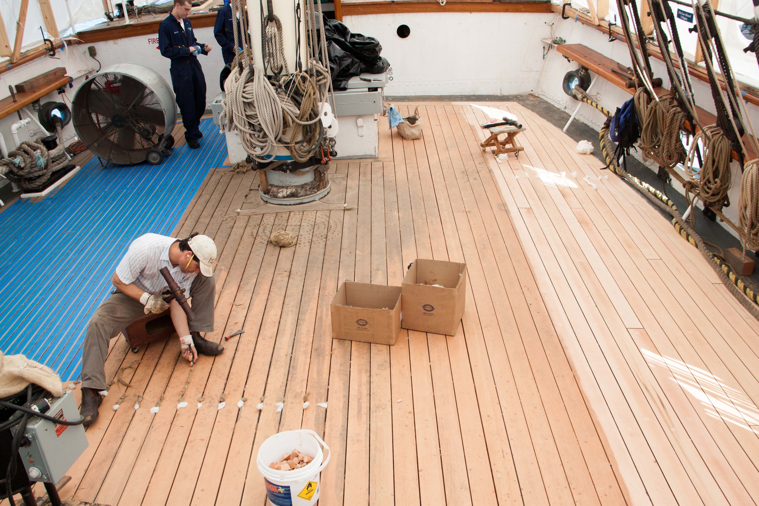 Andros caulking the deck