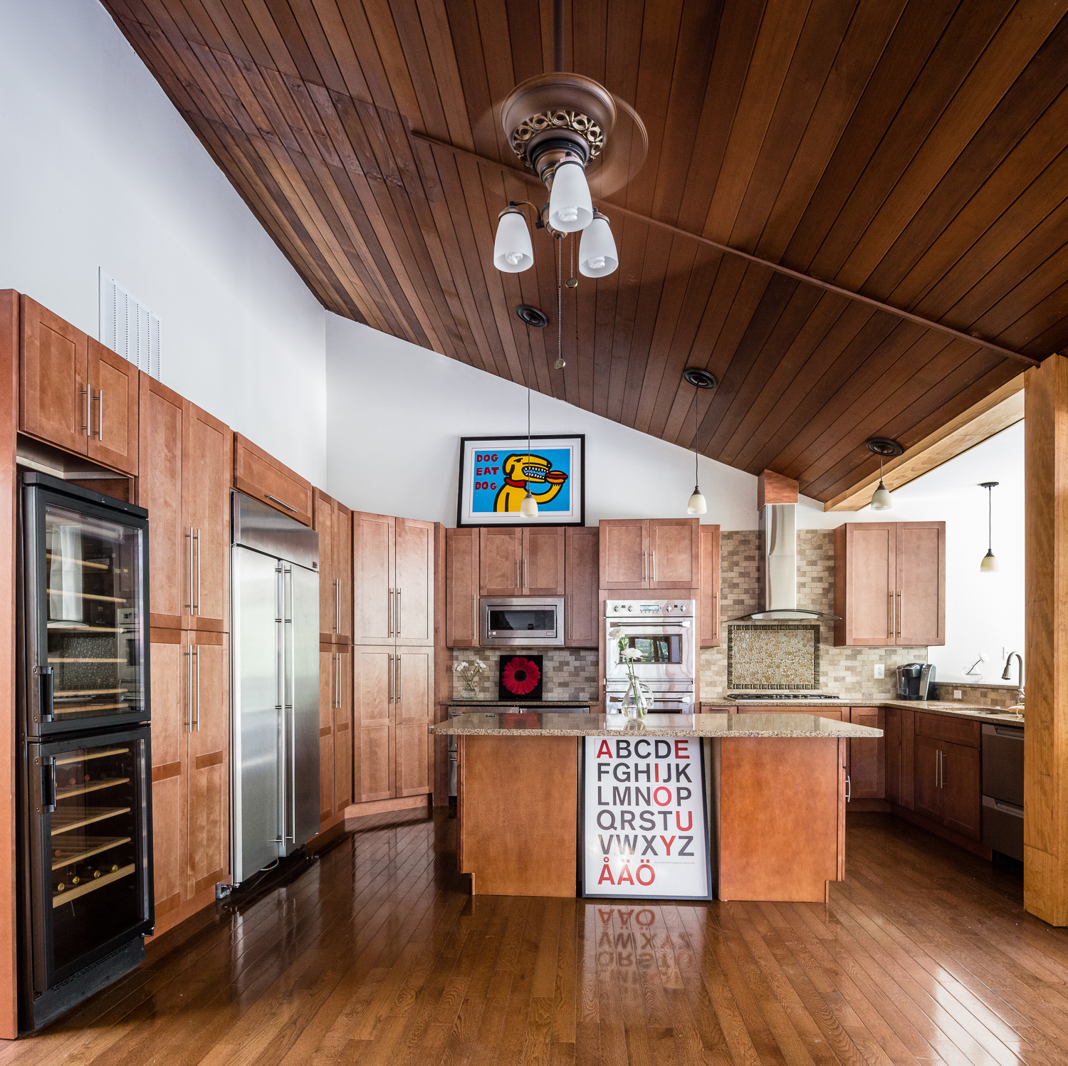 Modern Kitchen with lots of wood   Architecture by Bloomfield Architects