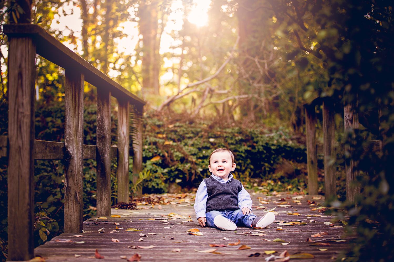 Portrait of a baby sitting on the bridge at Appleford Estate in Villanova