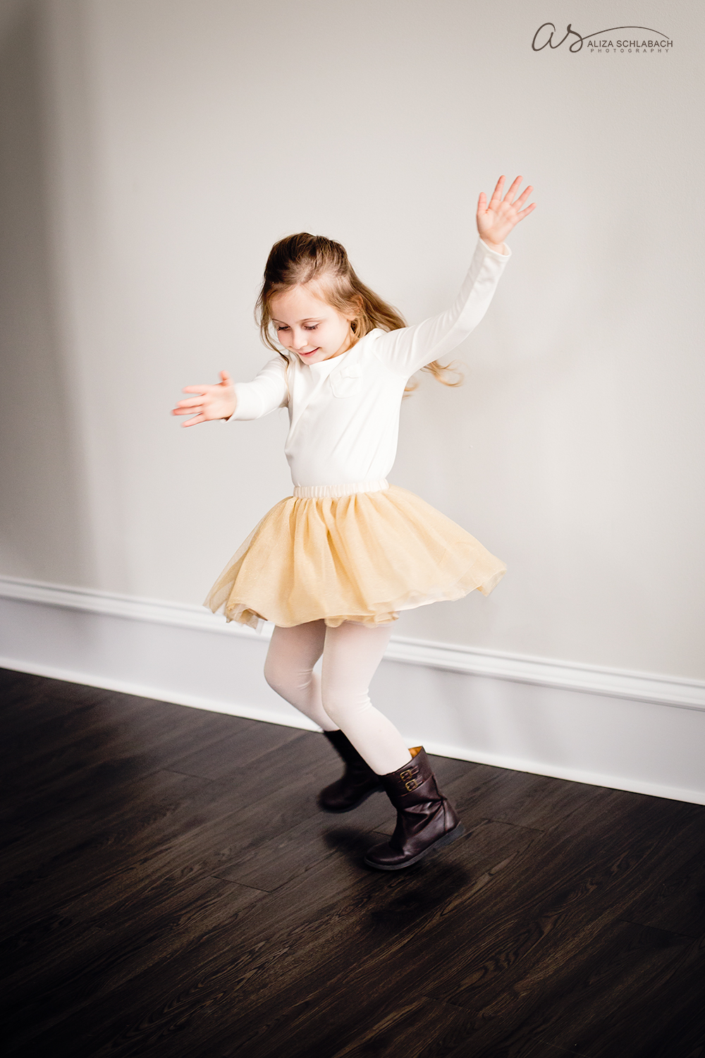 Photo of four year old girl playing and jumping in a tutu