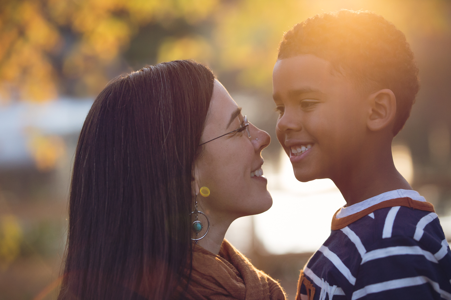 Cute close up portrait of a mom and her son in the fall