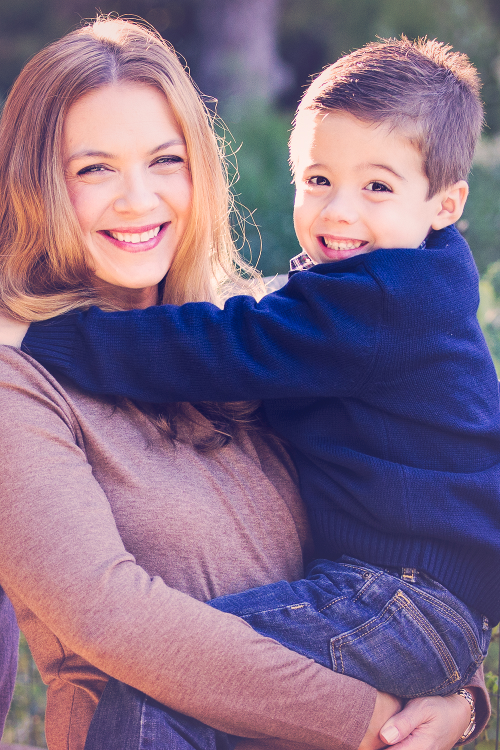 Photo of a smiling mom holding her happy little boy, Fall photo