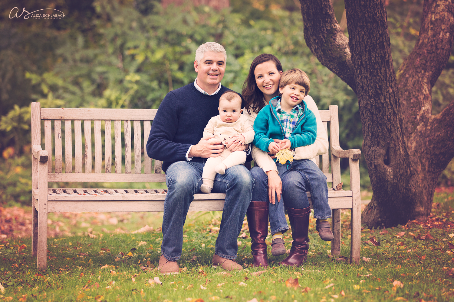 Family photo on a bench at The Grange Estate in Havertown