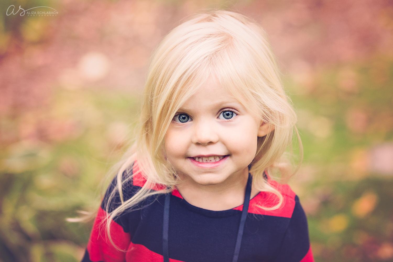 Cute blonde girl in autumn