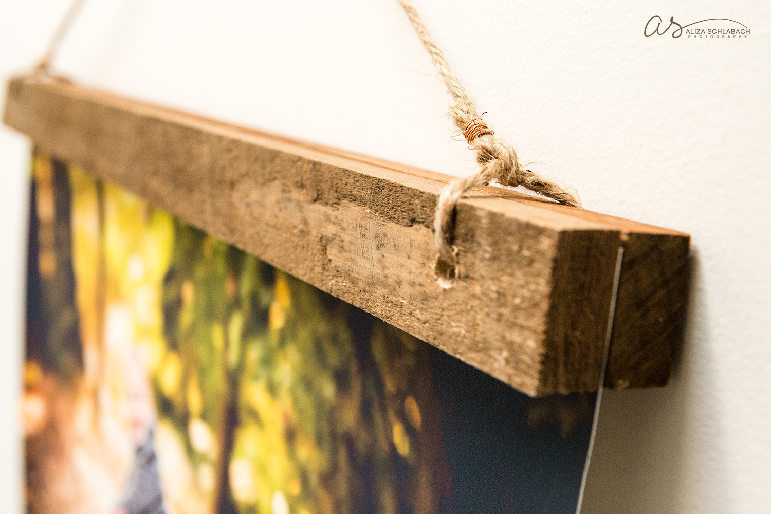 Detail of canvas mounted between pieces of reclaimed barnwood