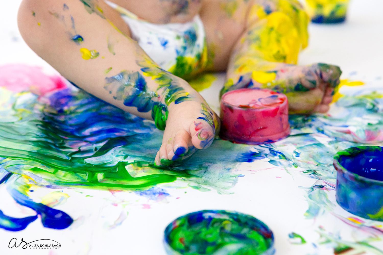 Photo: detail shot of fingerpaint covered feet
