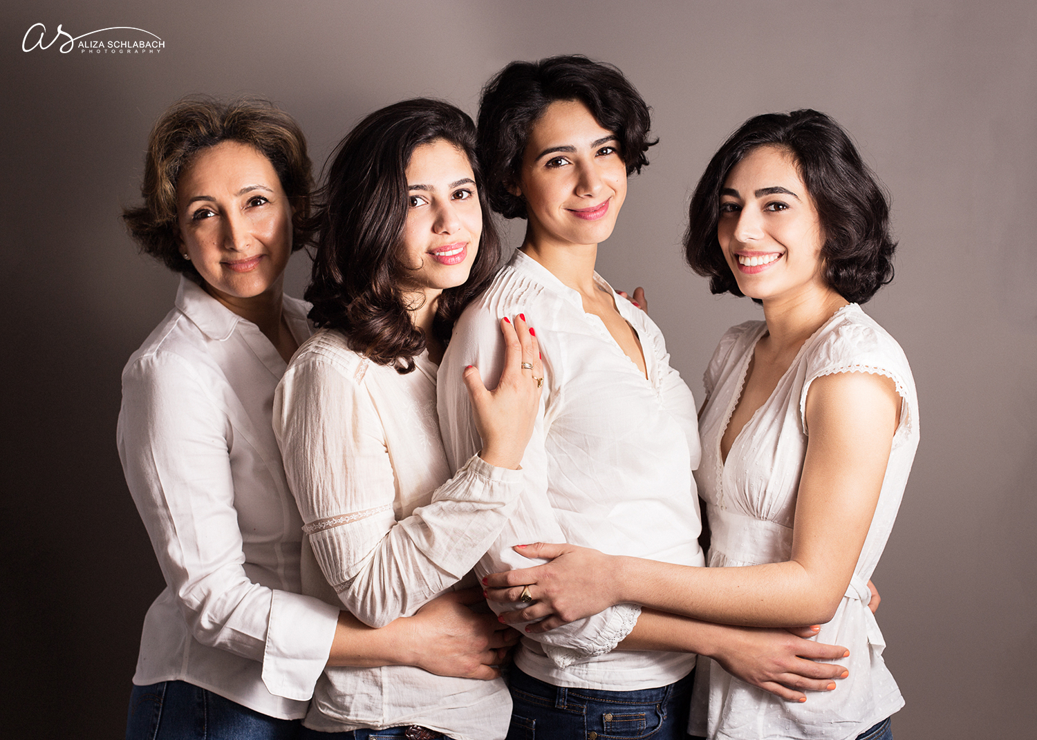 Portrait of three grown daughters and their beautiful mother