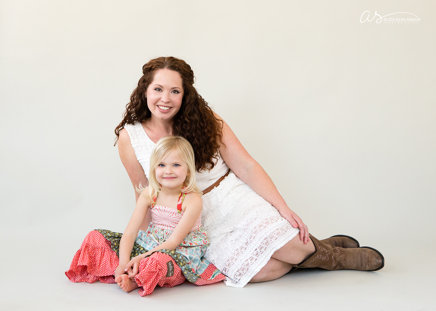 Studio portrait of a mother and her blonde little girl