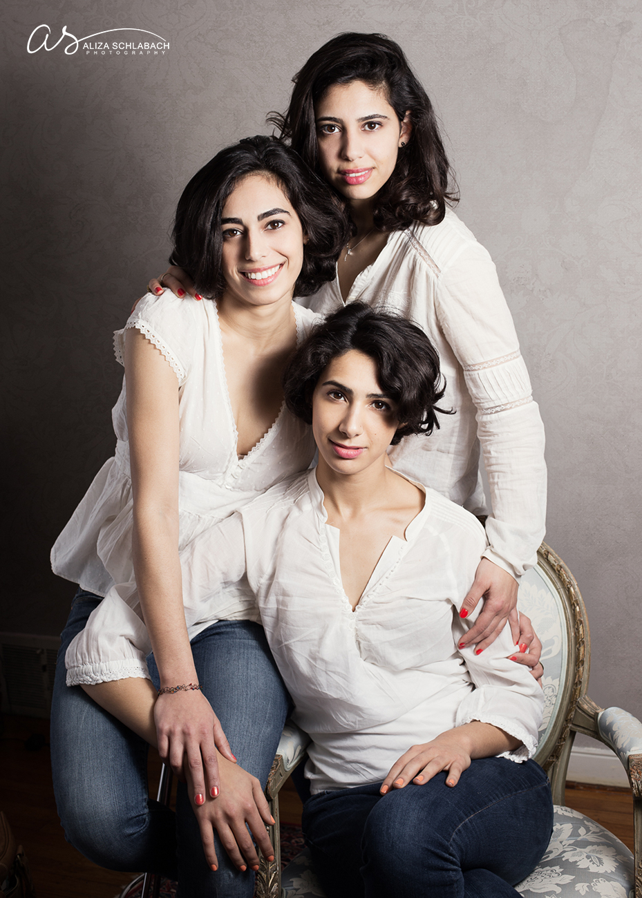 Formal portrait of 3 grown daughters